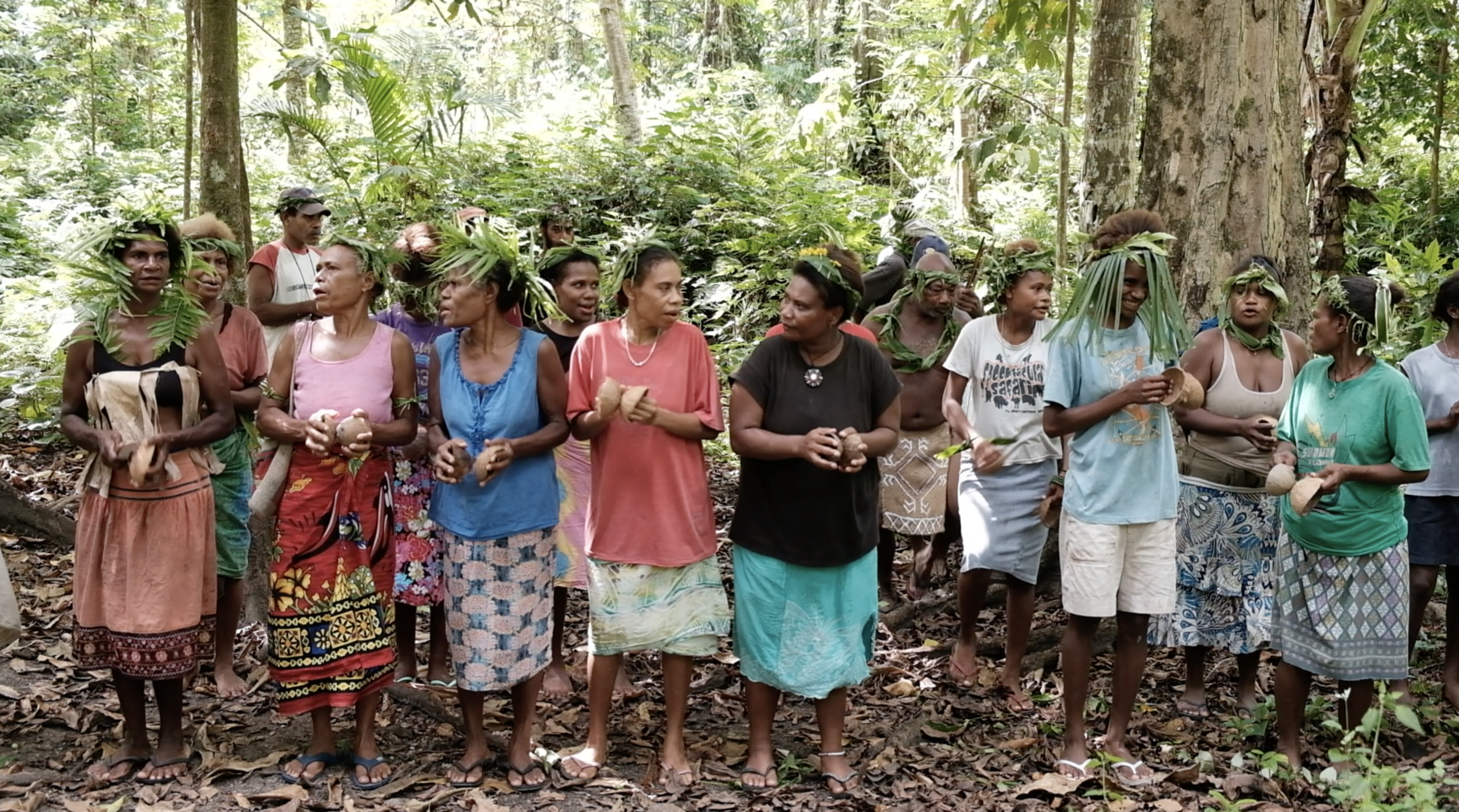 Women of Tuwo gather in the forest to perform a traditional  kastom  song about the changing climate. Knowledge about crops, weather and seasons has been passed down through stories and songs generations, but changes in the climate make this guidance less reliable.