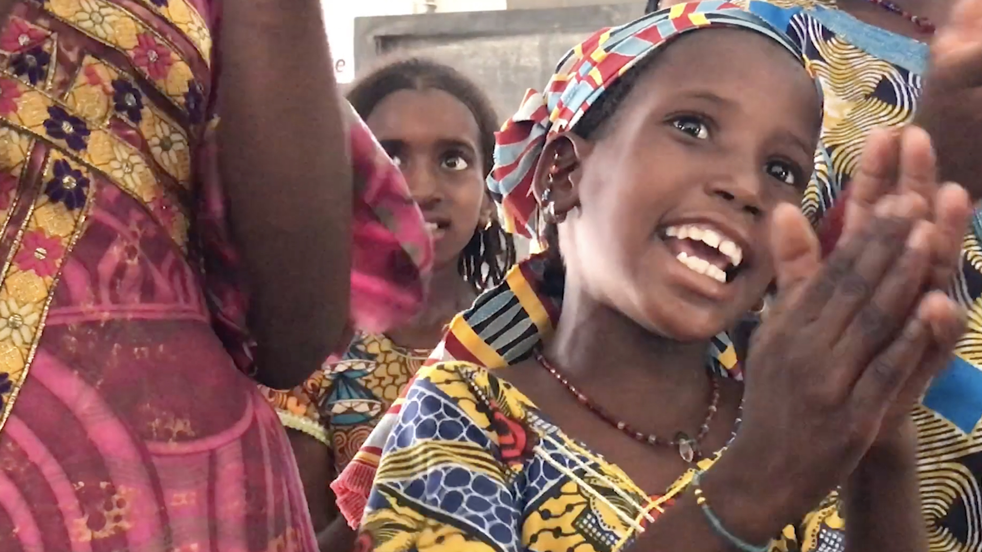 A fulani girls leads a traditional song in a UNICEF tent setup to help the children recover from the trauma of displacement through games and play.