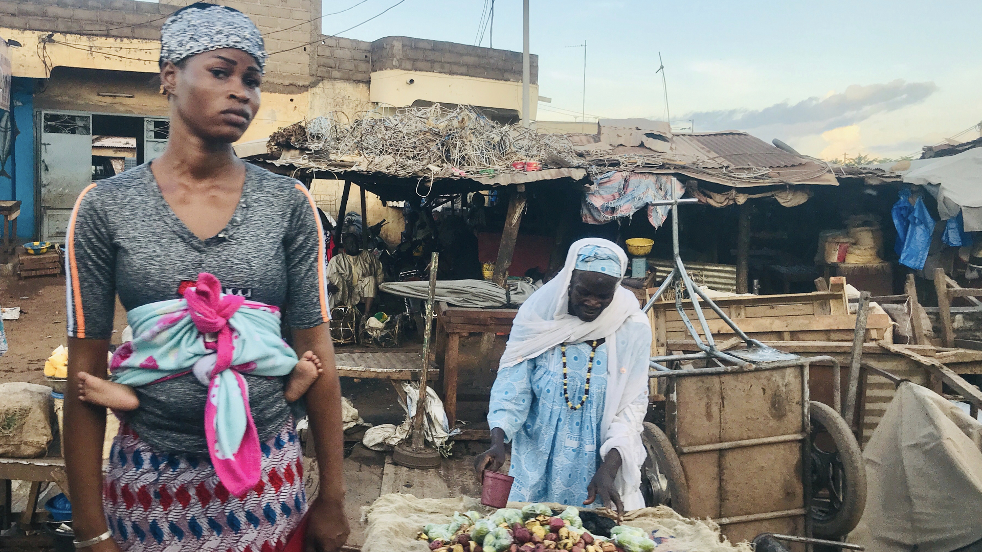 Women at a market in Bamako. Violence has forced many to seek safety in the capital, staying with extended family. By the spike in population to Bamako has created increased demand for limited services like health and education. In a country that was already coping with challenges of poverty, the crisis has made matters worse.