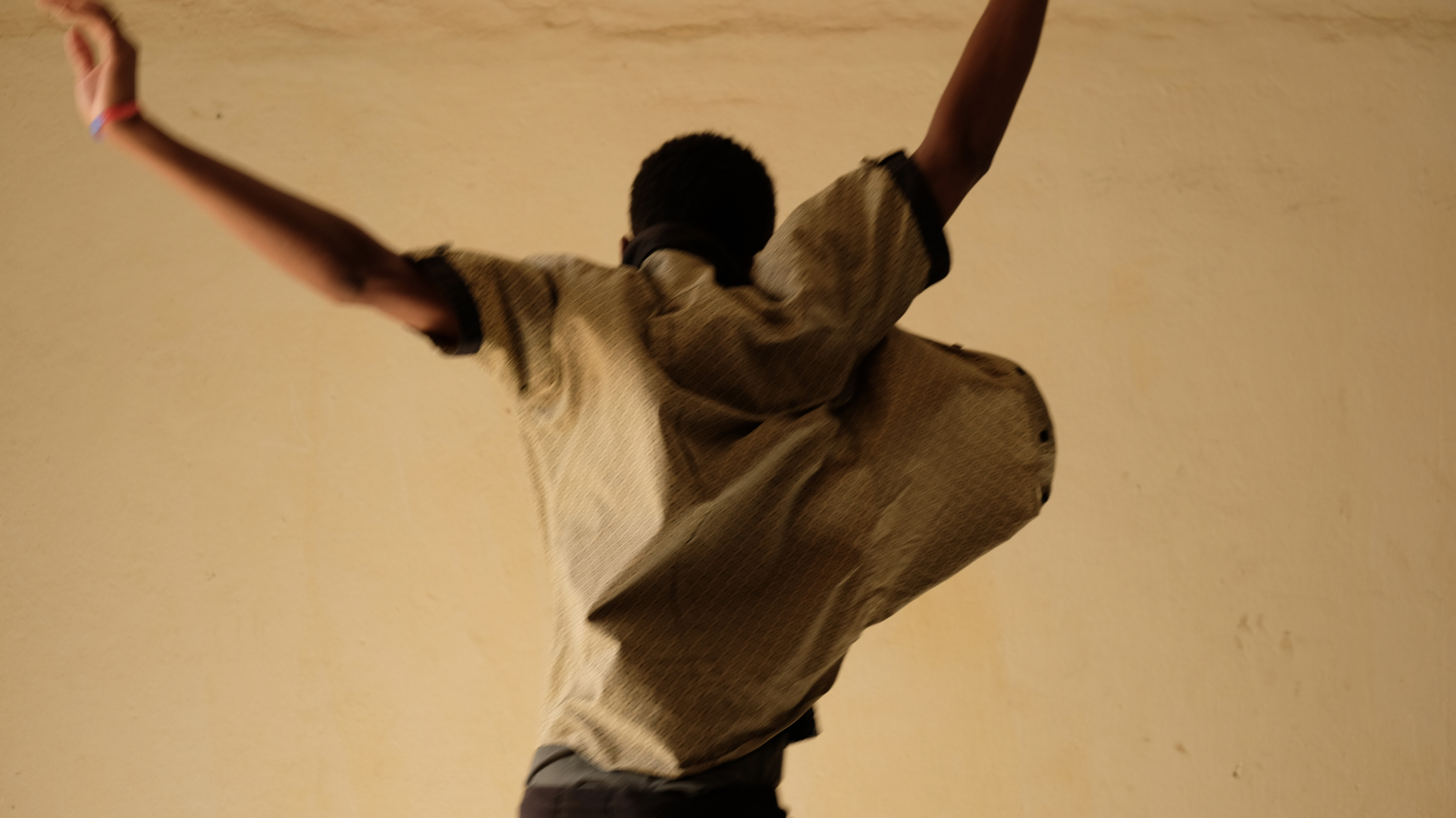 Ismael, age 16, takes flight at a center for children who have been released from the military detention center in Gao. The boys are often arrested with adults and held in the same cell. UNICEF continues to advocate for the immediate release of any children in custody. At centers like this, they are given counselling and support to get back home and rebuild their lives. Boys like Ismael are able to get small grants to help them get started in their new life.
