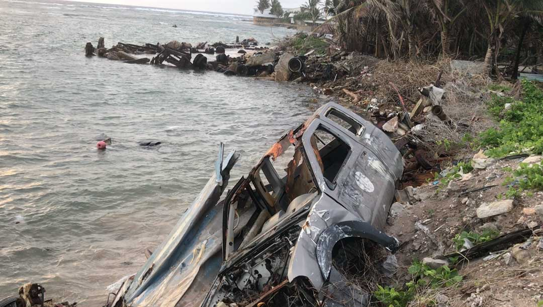 A rusted car makes up part of an improvised sea wall to stop erosion on Majuro atoll in the Marshall Islands. With rising sea levels and climate changes posing major challenges for the island nation, the government is investing in early childhood development to help their children thrive in school and development sustainable solutions to these imminent threats.