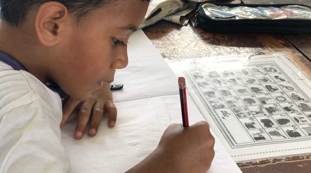 A Fijian boy practices his ABCs at Yet Sen Primary School in Suva. Investments in education in Fiji are starting to show promising results but teachers say that without parental involvement and continued learning at home, school work is not enough.