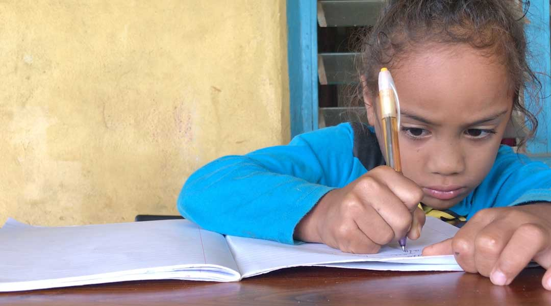 Naomi sits down to do her homework at her house in Lavengatonga on the eastern end of Tongatapu in the Kingdom of Tonga. She was part of a World Bank supported early childhood learning project called Pearl and her mom says it's given her a headstart when she started primary school.