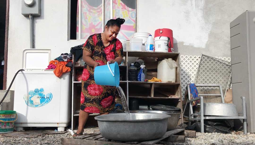 Liann Lorennij pours out the water to do the washing up at her house in Majuro in the Marshall Islands. As the mother of 8 children living in a house with more than 3o people, she says there is always laundry or dishes to do but the extended family of cousins, brothers and sisters all help out to raise the kids and contribute to the household. The government's focus on early childhood development will help mom's like3 Liann by creating more opportunities for preschool so she may get a moment to herself.