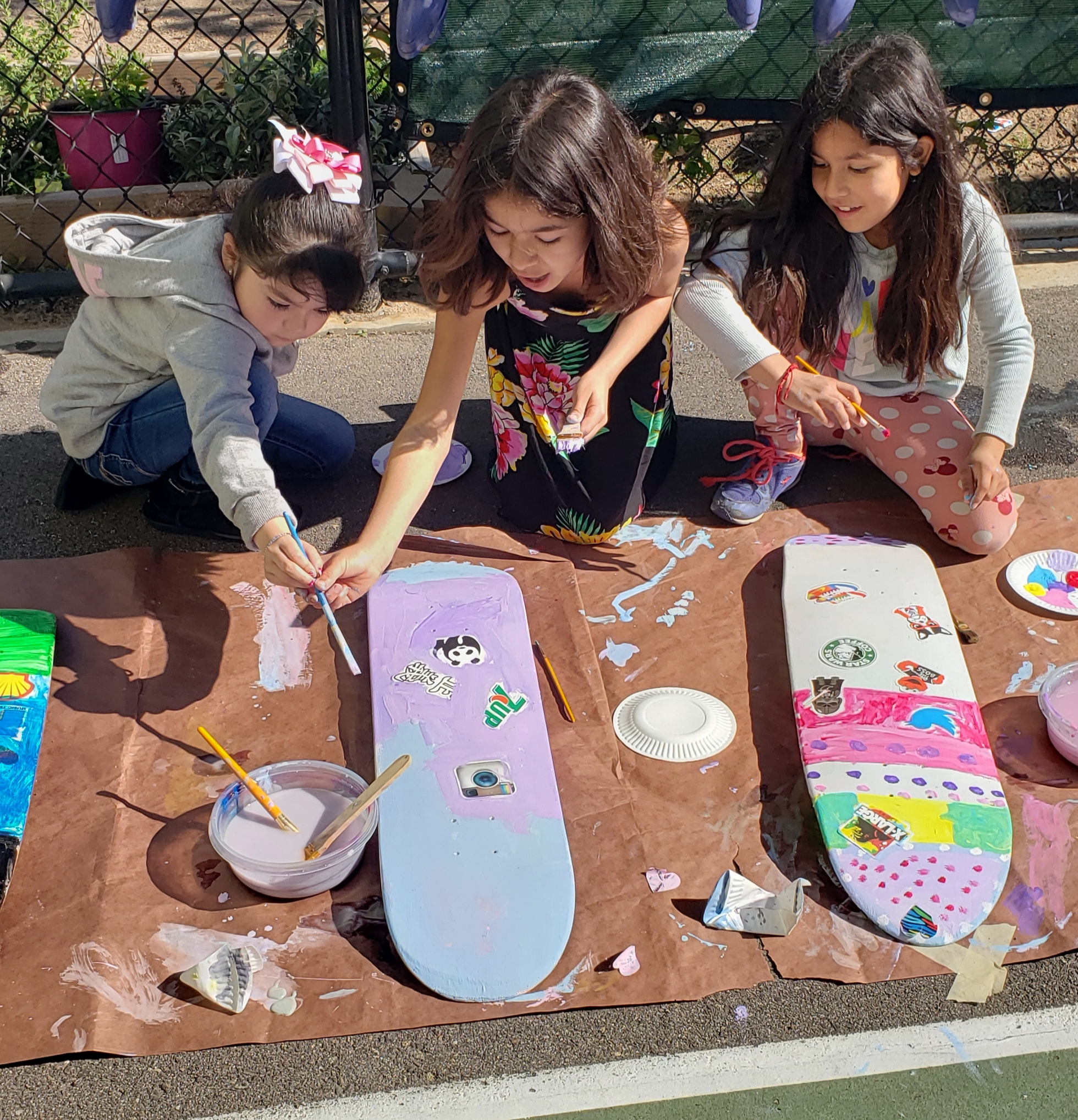 Monarch Art Project - April 2019Rebecca Bauer, our friend and artist in the community, helped our kids design and paint their own skateboard.