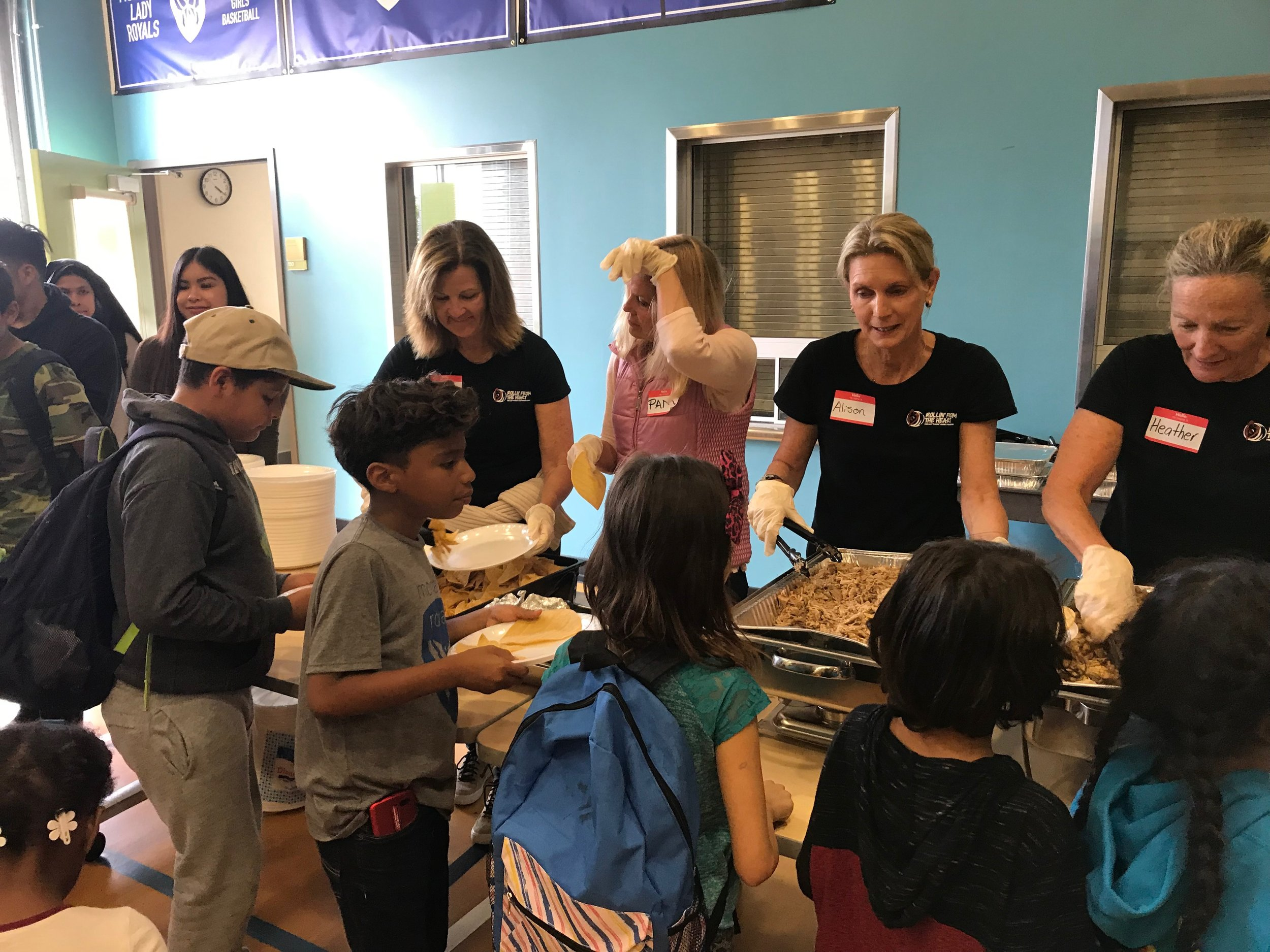 Monarch Dinner - May 2019RFTH volunteers helped serve over 400 families dinner. We are thankful to help this community and meet the families of kids in our after school program.