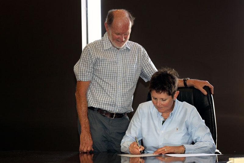 Lisa Glastonbury, Wagga Rail Trail chairperson, signing the Implementation Plan contract