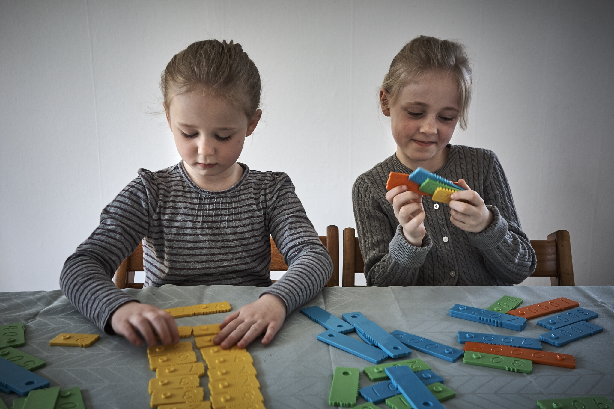 The newmero bricks are educational toys for girls.