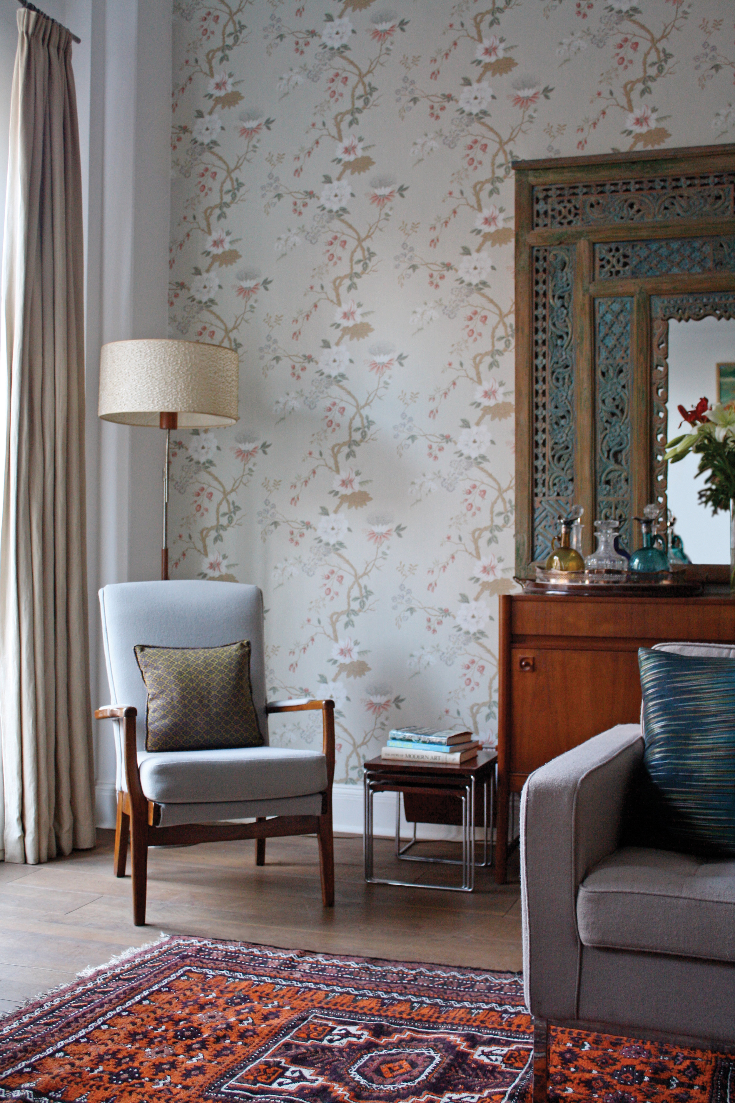 Layering of pattern, texture, depth of hue and furniture of differing periods and places