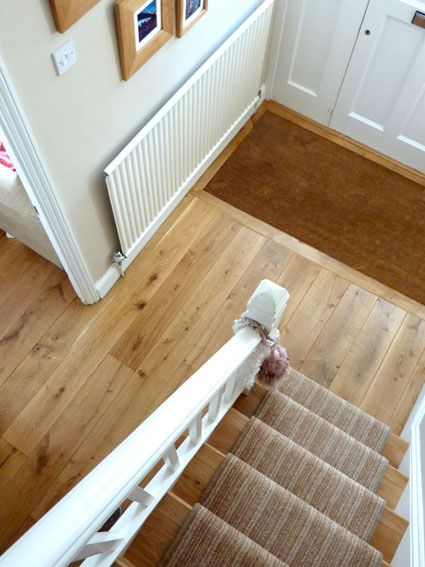The practicality of the door mat sunk to flow with the oak floor from Fine Oak Flooring