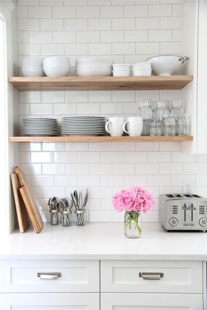 Love the cabinets, subway tile backsplash, and wooden open shelving!   source
