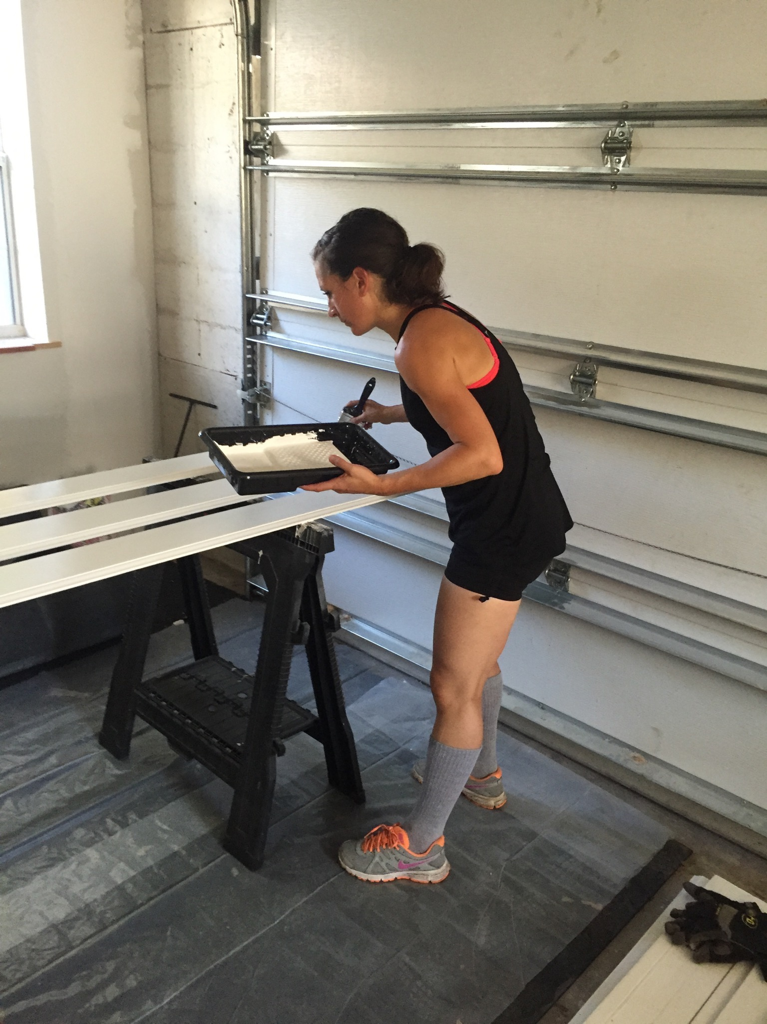 Courtney in the baseboard painting zone!