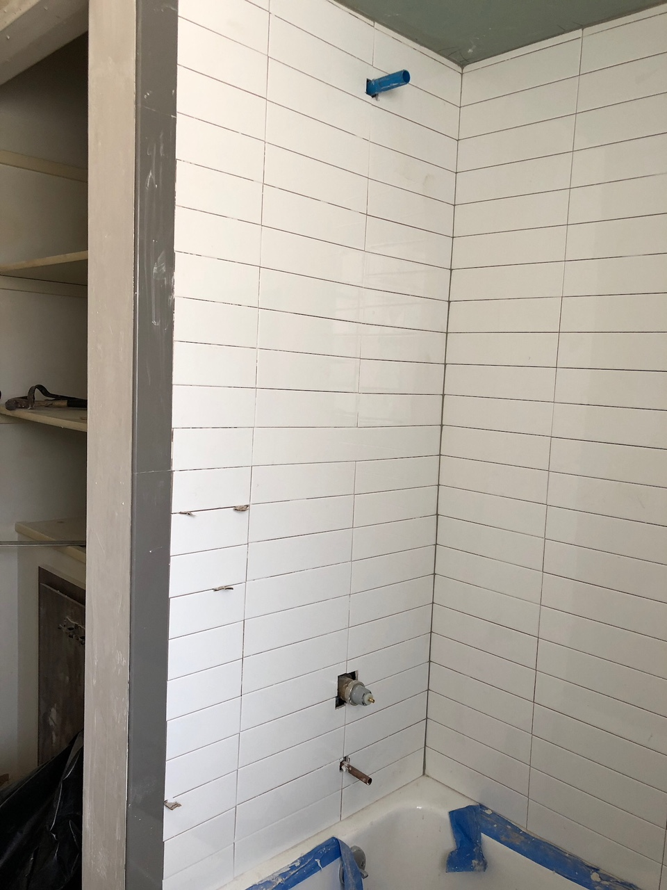 stacked subway tile in shower