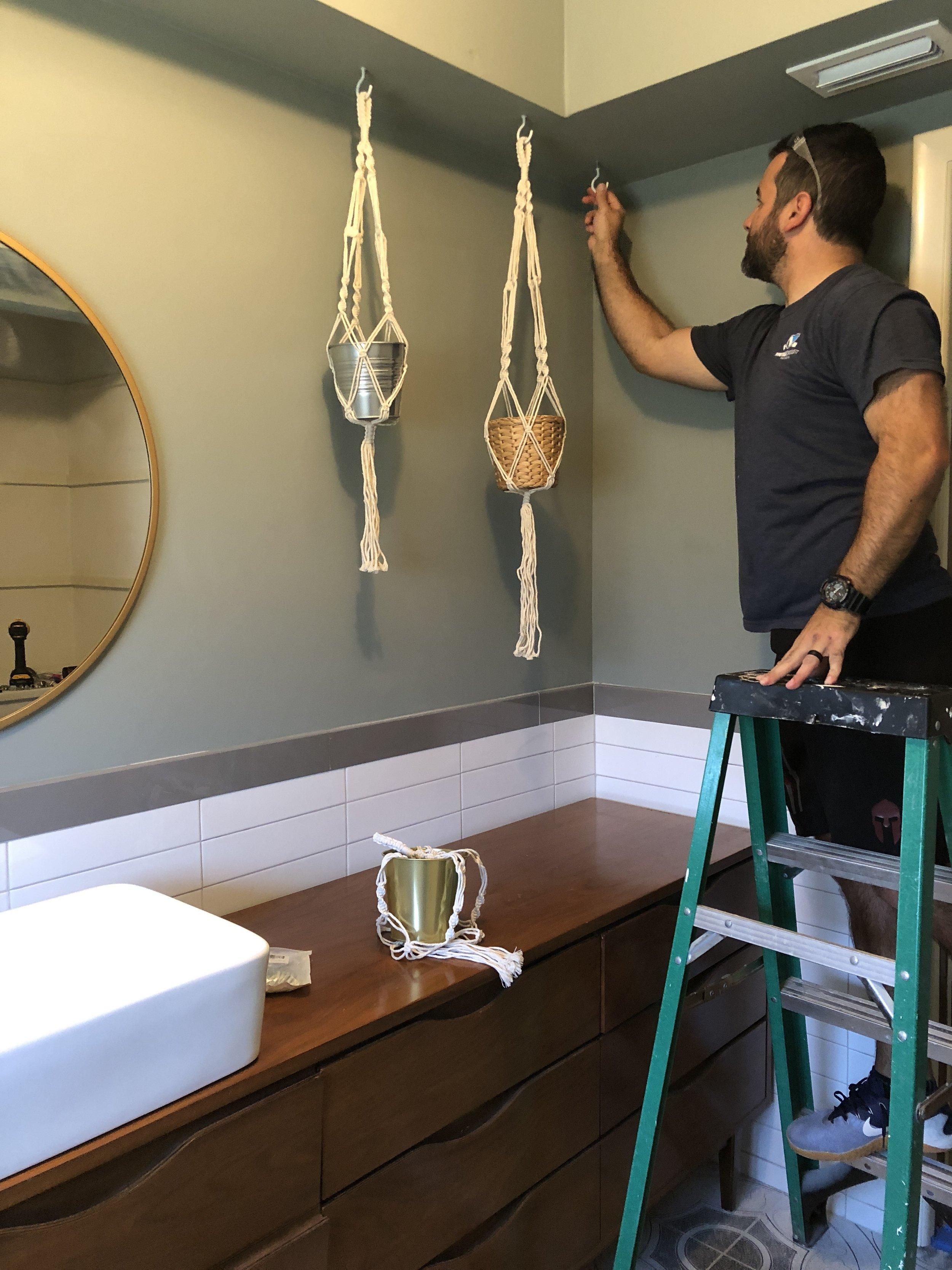 Hanging planters in bathroom