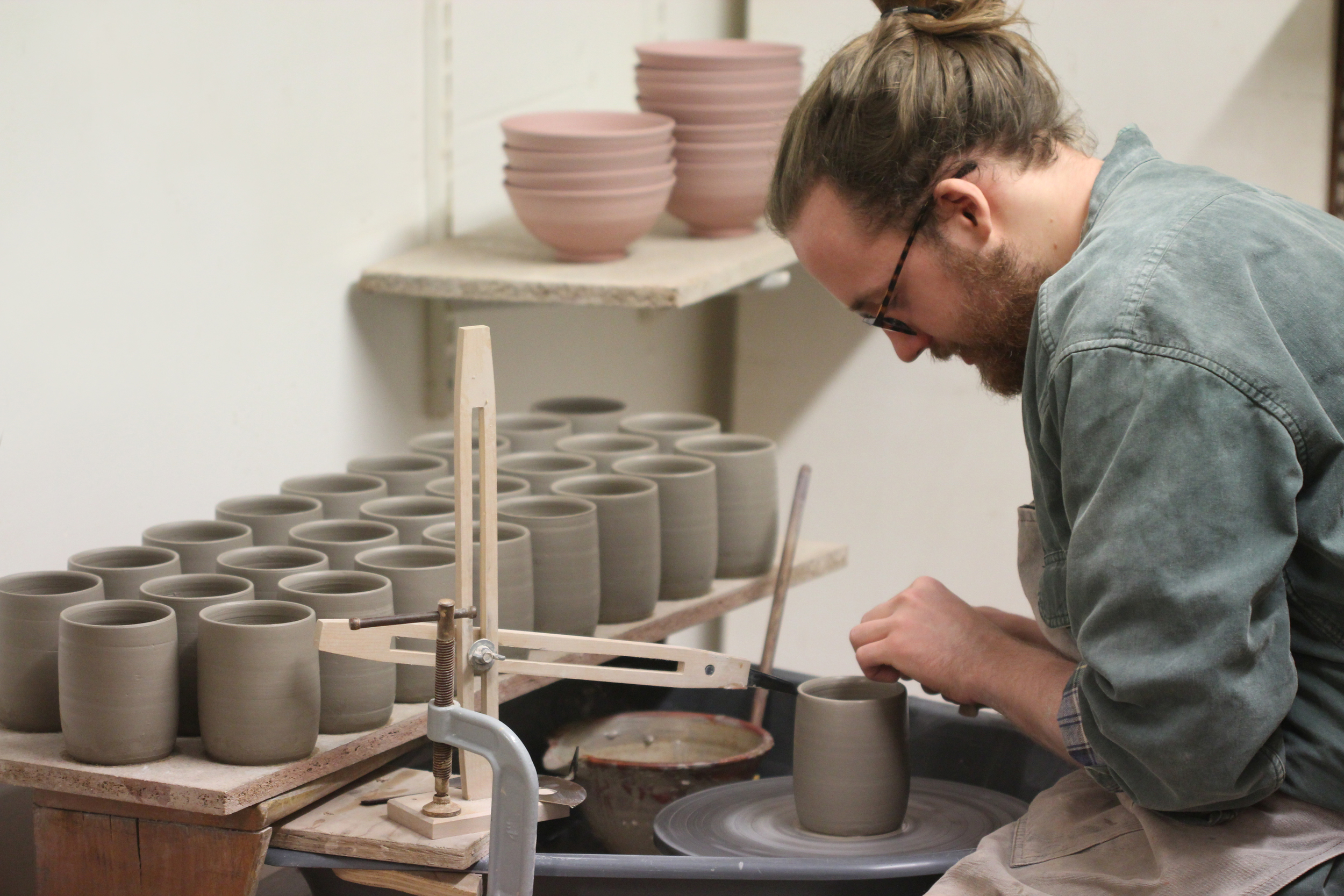 Throwing a batch of standard-ware mugs to be soda fired at Maze Hill Pottery.
