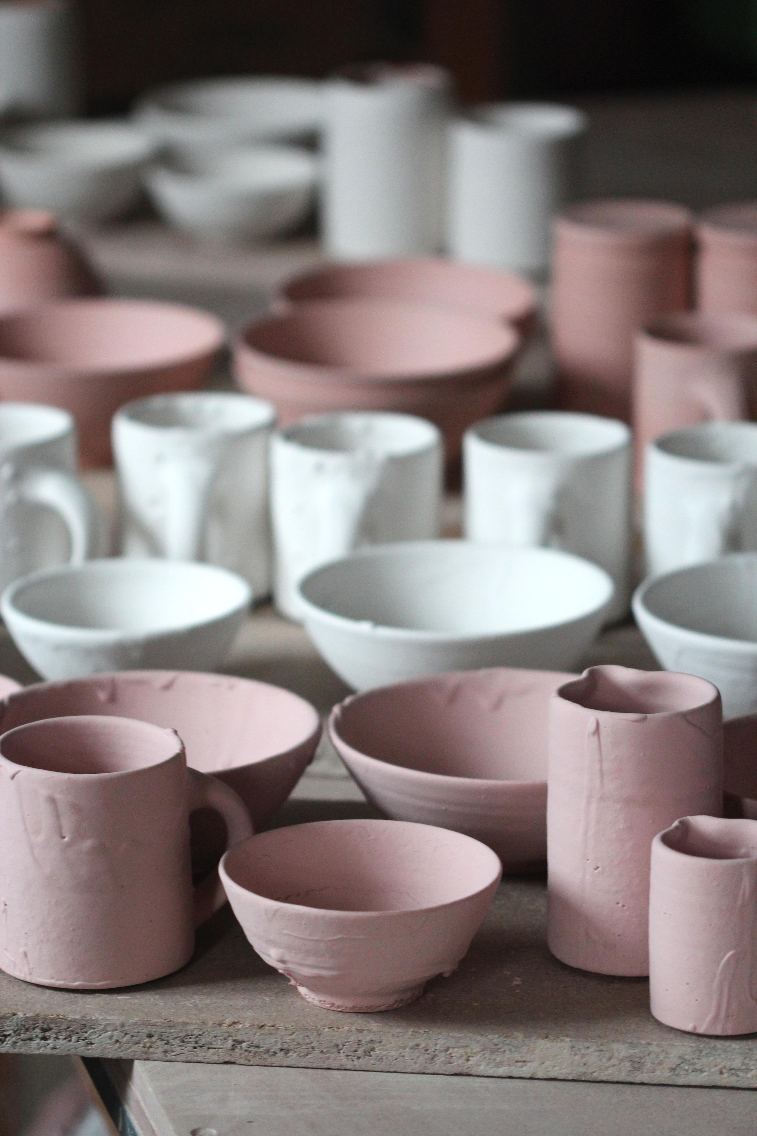 Freshly glazed pots.