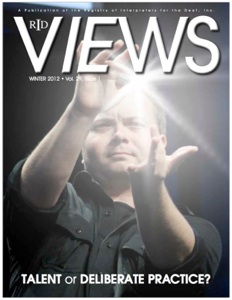 """The cover of The Views magazine with Wink on the cover. Wink is wearing a black button up shirt signing the ASL word """"Twirl around the town"""" with an added photo lens flair between his middle fingers"""
