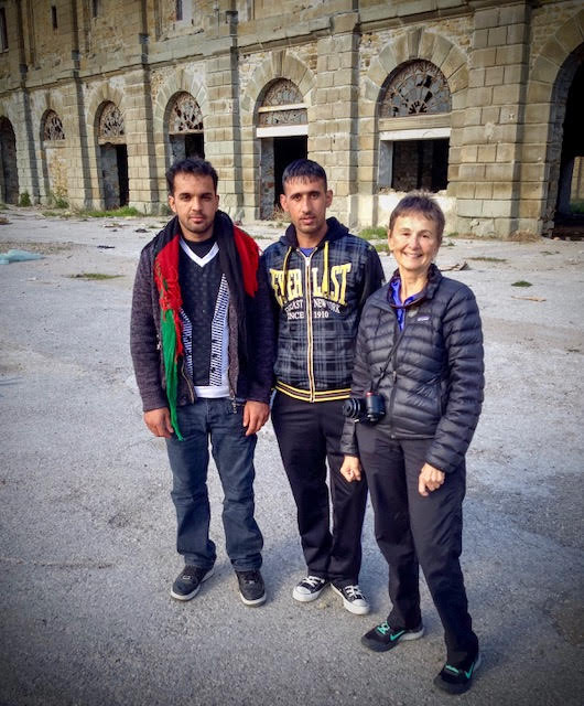 With Afghan refugees, 2014, in an abandoned dockyard at the port of Trieste, now in Italy. When we lived there it was a United Nations protectorate, still being fought over by Italy and Yugoslavia.