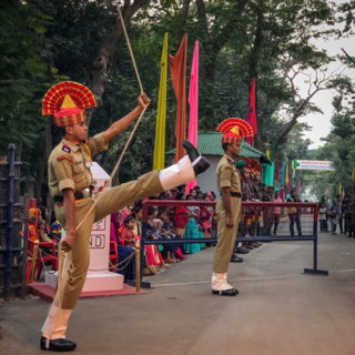 Indian border soldier in flag lowering ceremony.