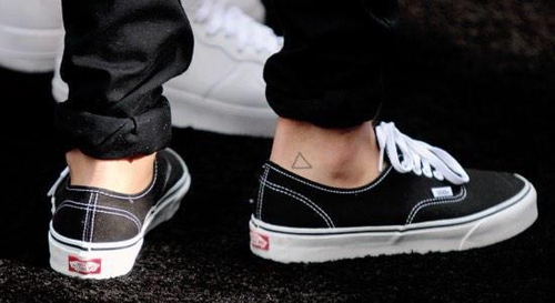 Louis in Vans showing off his triangle tattoo