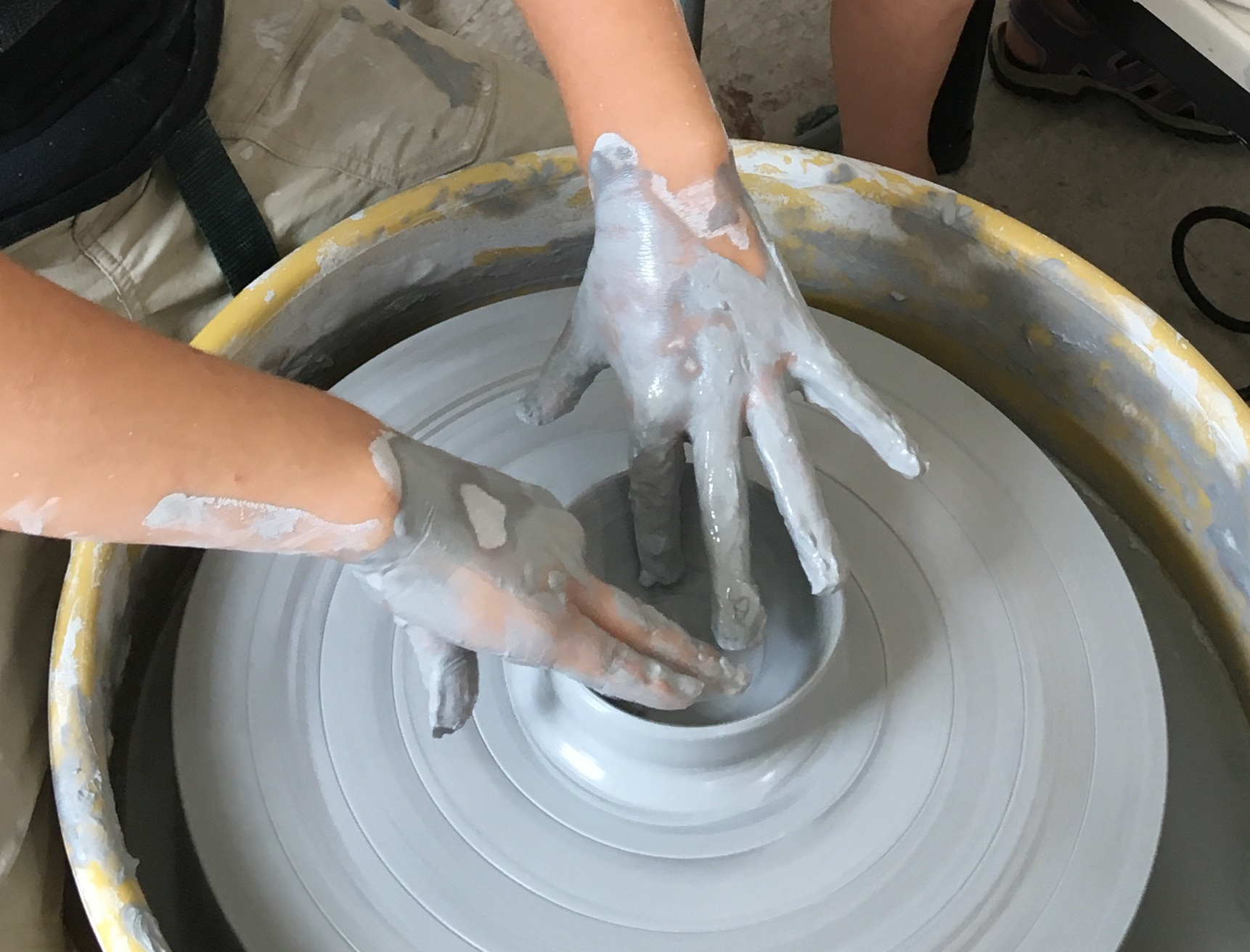 Learning to use the pottery wheel