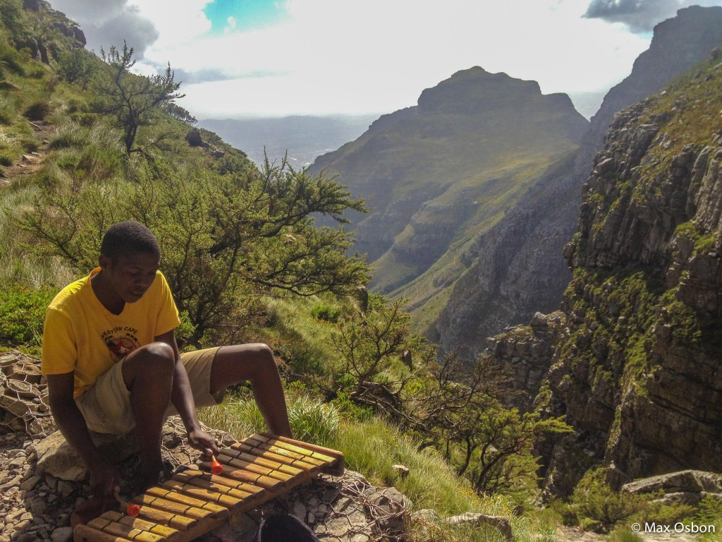 This guy hangs out near the top of Table Mountain playing music all day.