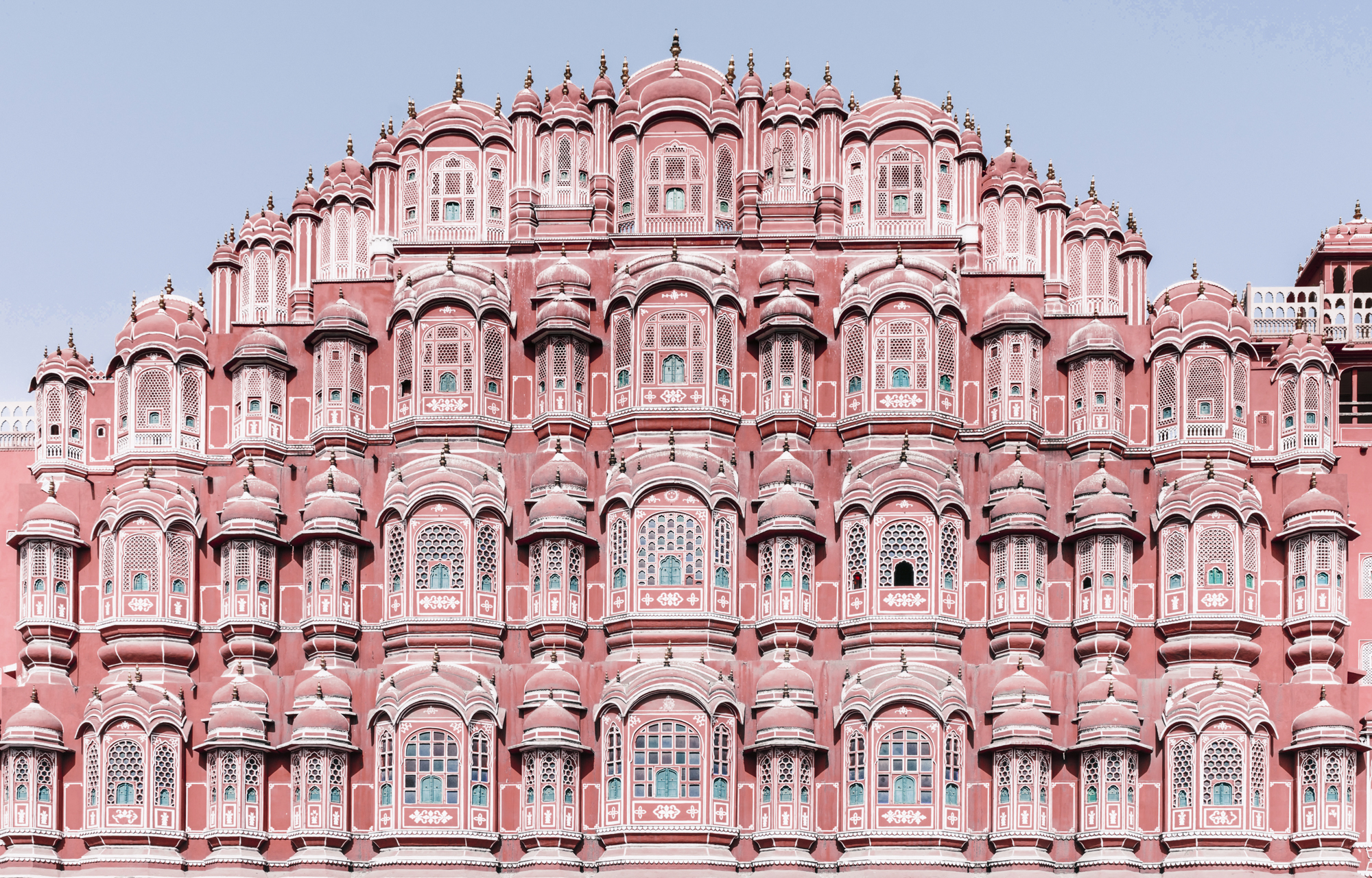 """Jaipur - While staying at a quintessential Haveli (onetime royal palace) with peacock-blue hallways and magnolia-fringed Moghal gardens, experience the capital of the """"Land of Kings"""". Jaipur is a pink-washed city crystalized by age-old royalty studded with royal pavilions, ornate gardens and unicolored palace fronts that take your breath away with their intricate design and imposing size. Take on the busy craft bazaar with an expert shopper and meet masters of crafts in their workshops of traditional block printing, hand-spun khadi fabrics, and the almost-extinct jamdani weaving. Behind closed doors, stop by private ateliers of jewelry makers and metalwork artists who will show you their treasured pieces. Visit the craft-centered village of Bagru outside of Jaipur for the day to discover the origins of ancient traditions. Take your tastebuds on a culinary journey through a variety of dishes, served in street stalls and glamorous palaces."""