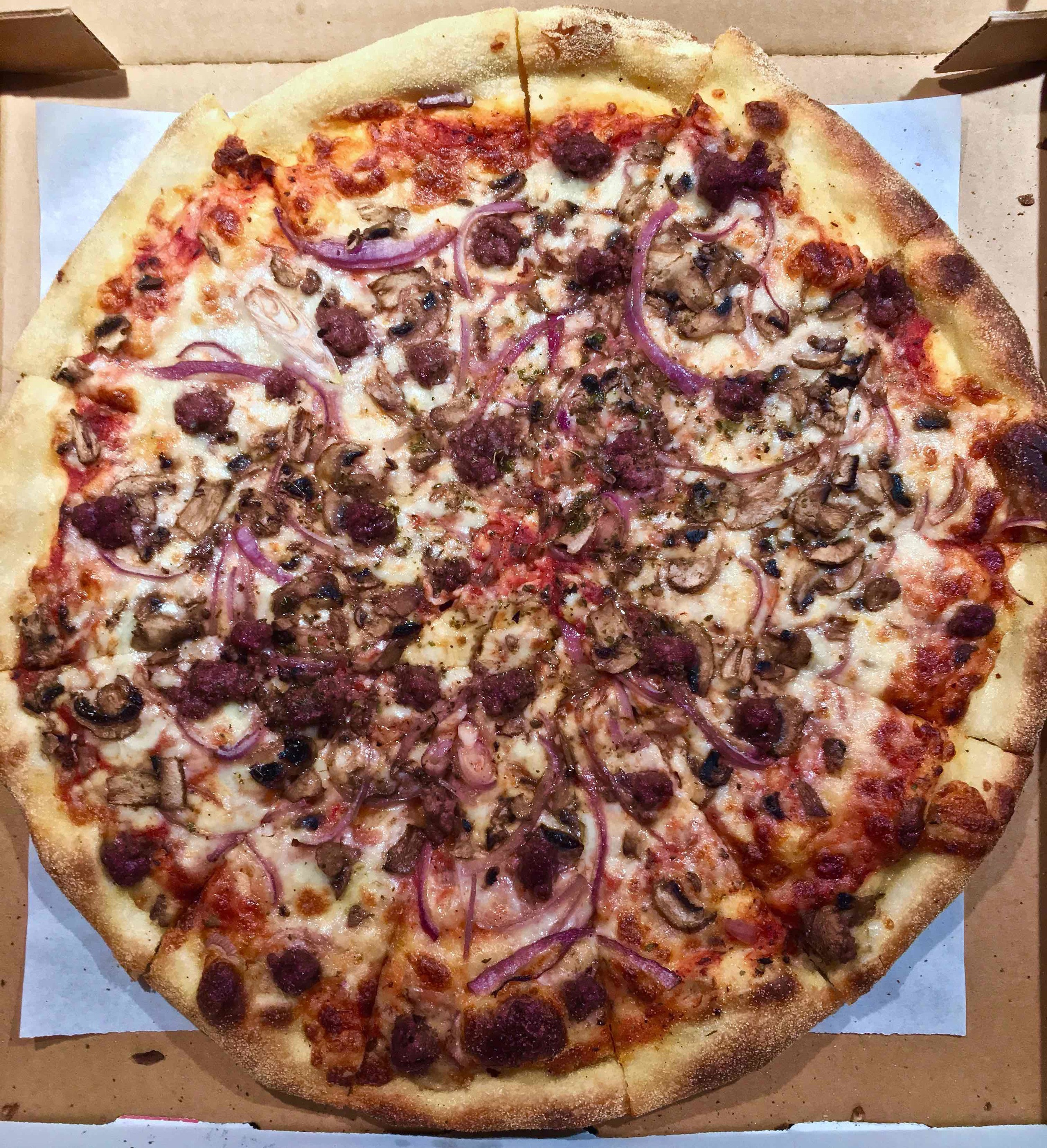 sourdough pizza with sausage, mushroom and red onion