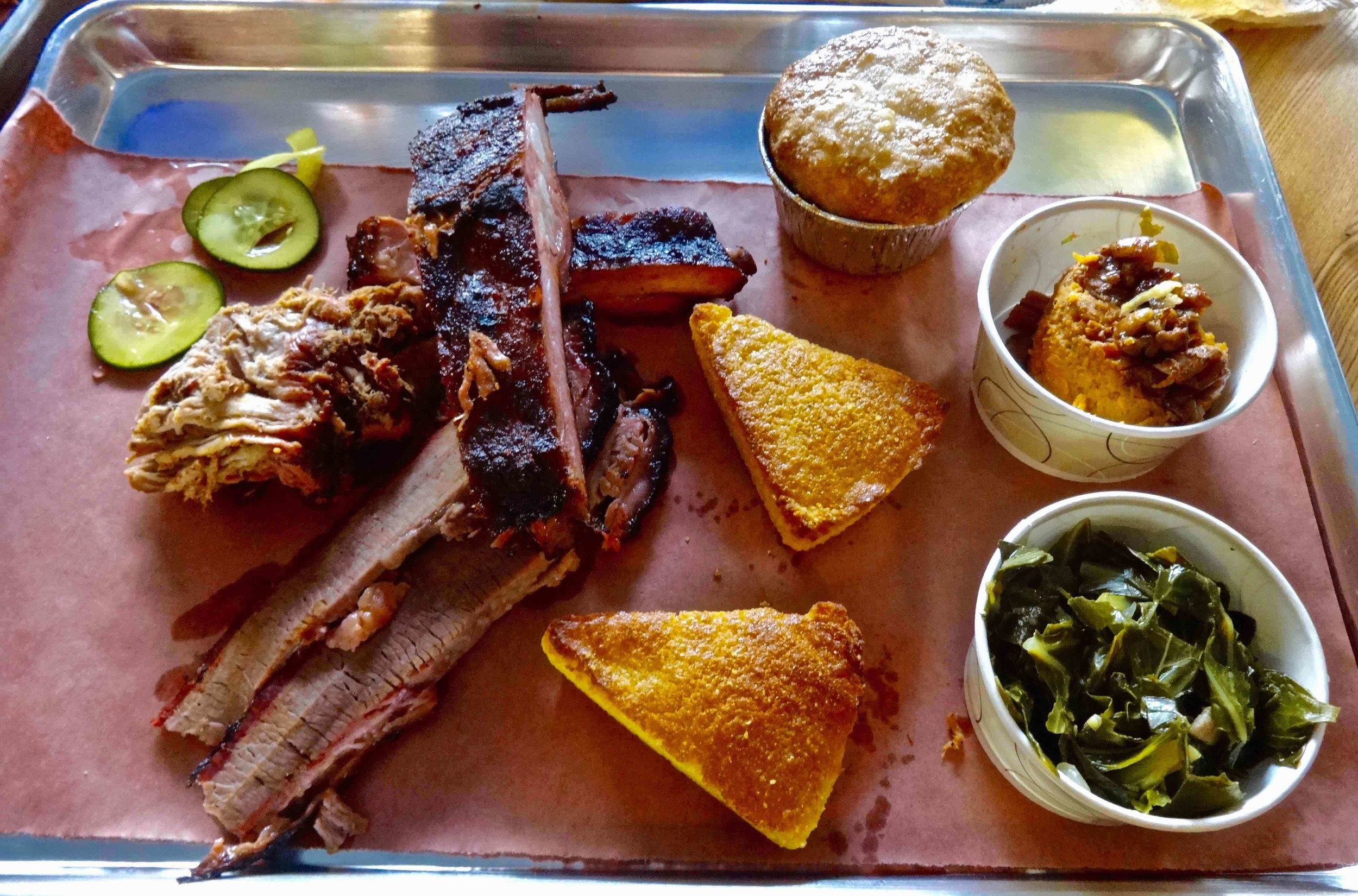 three meat plate with two sides, cornbread and cobbler