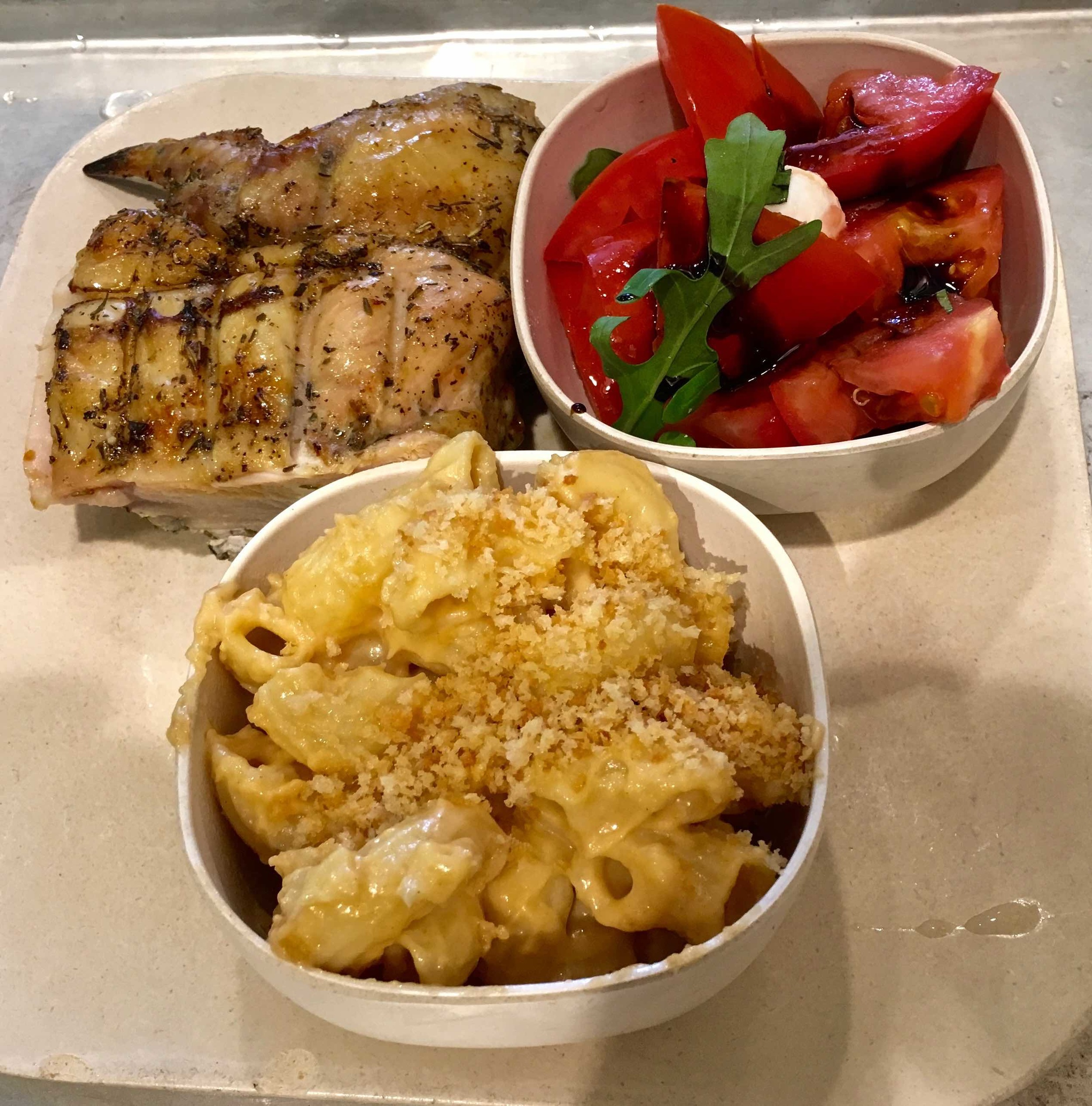 quarter Mediterranean chicken with mac and cheese and caprese salad