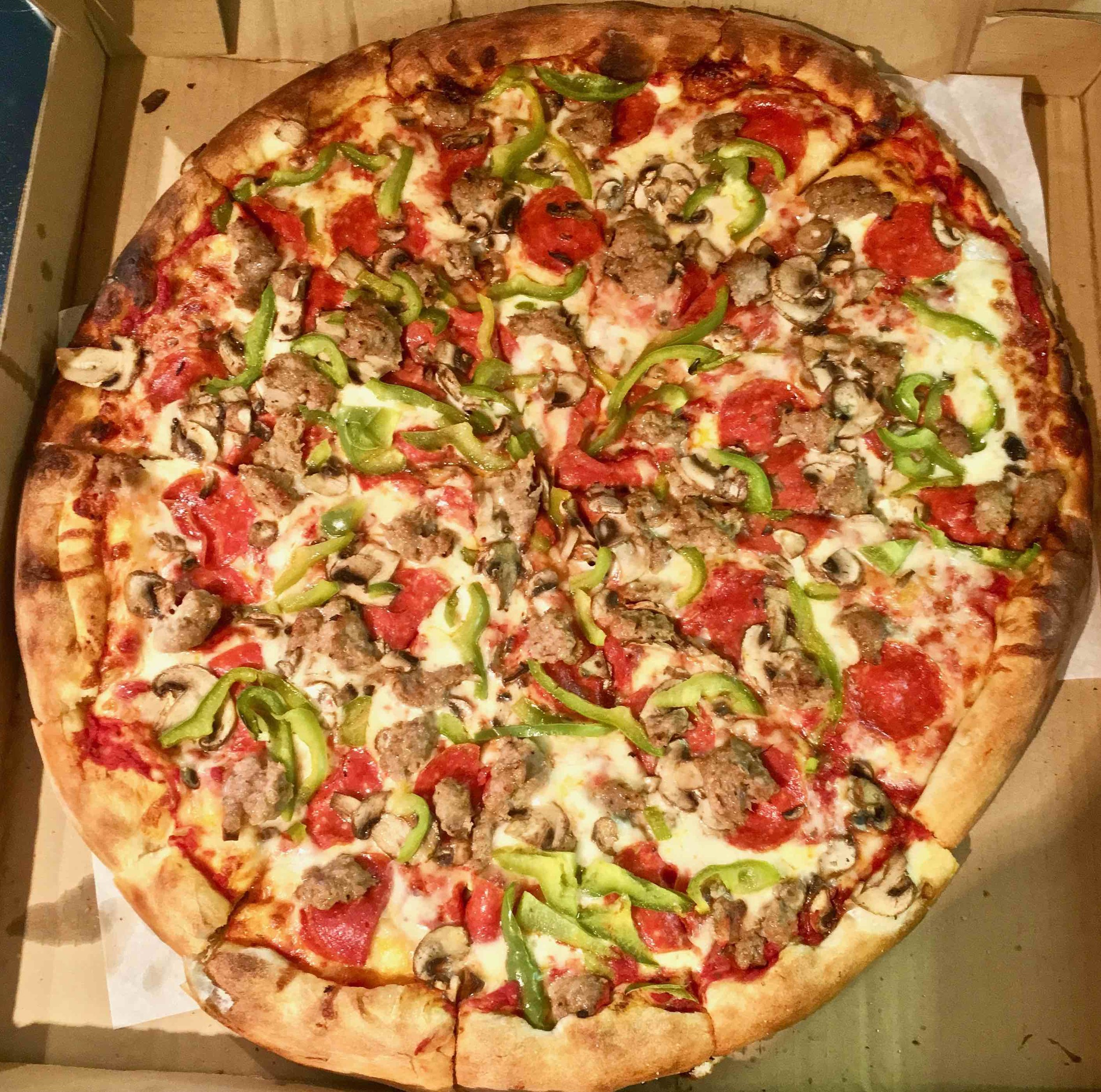 sausage pepperoni mushroom and green pepper pizza