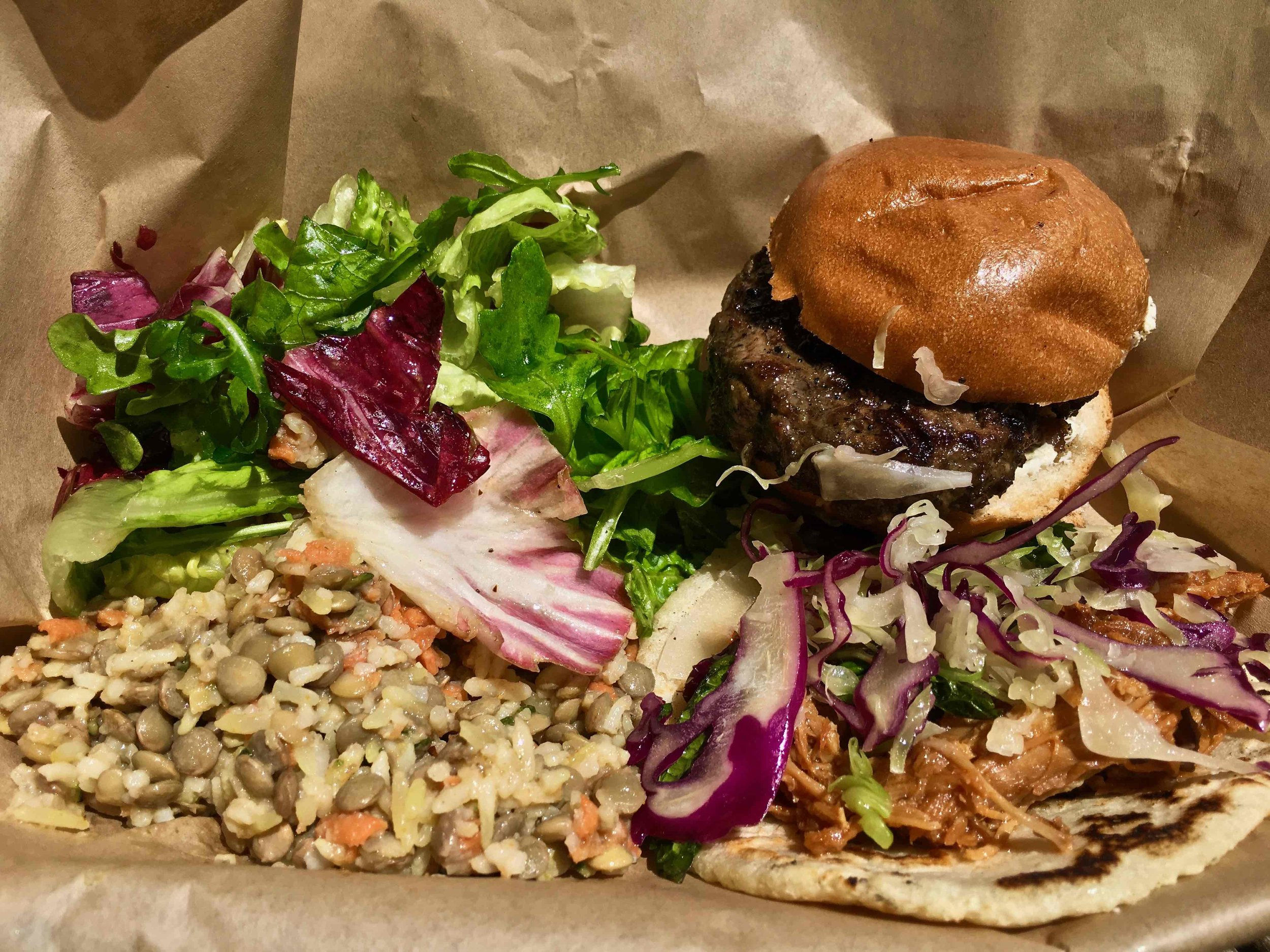 lamb slider with pulled pork taco and side salads