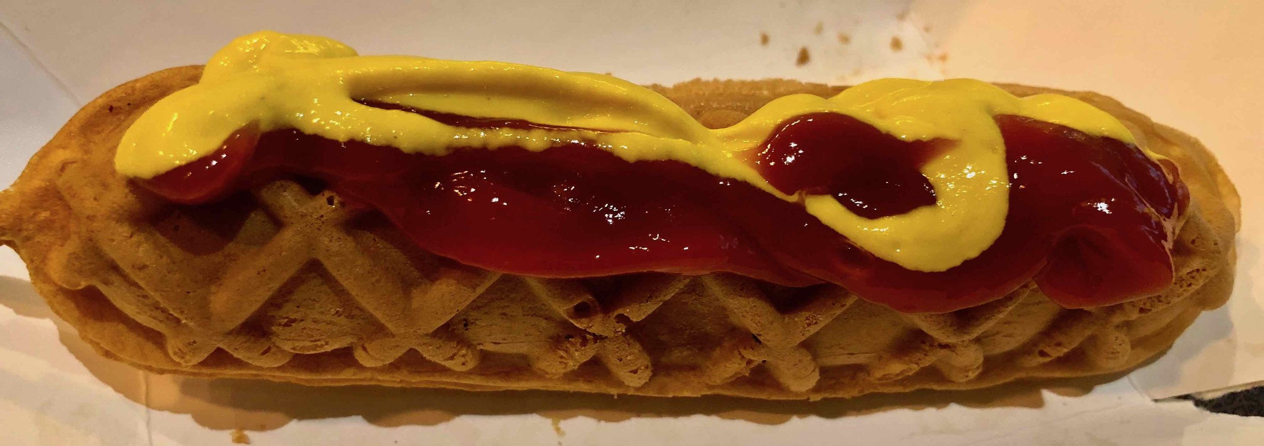 waffle dog with ketchup and mustard