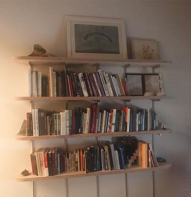 Dimly lit bookshelf. Go ahead, zoom in, take a deep breath in and now time to relaxxx. #librierge @waycoolergallery