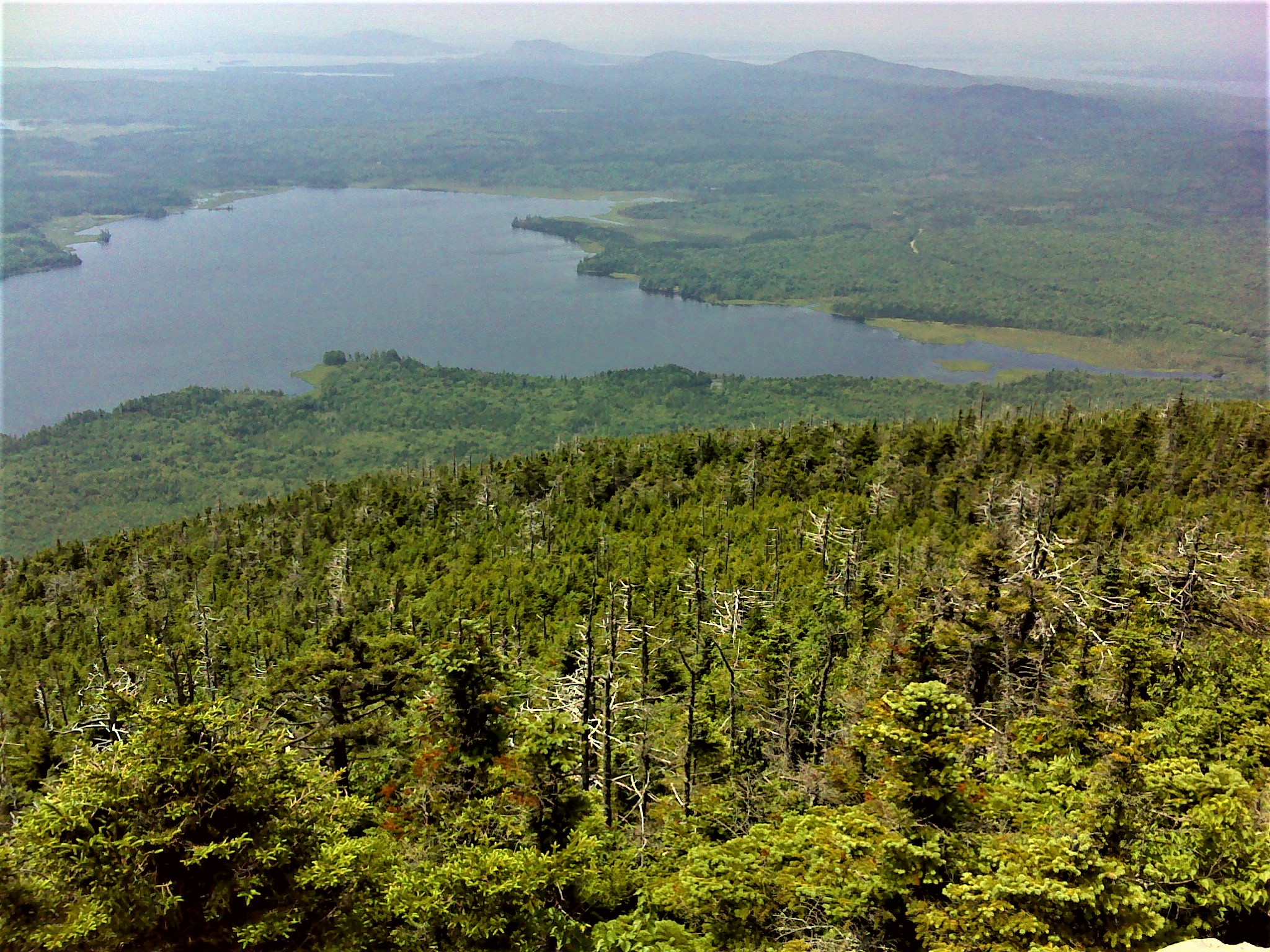 Looking west from the summit. The view is across Spencer Pond to Moosehead Lake. Notice Mount Kineo in the center on the horizon.