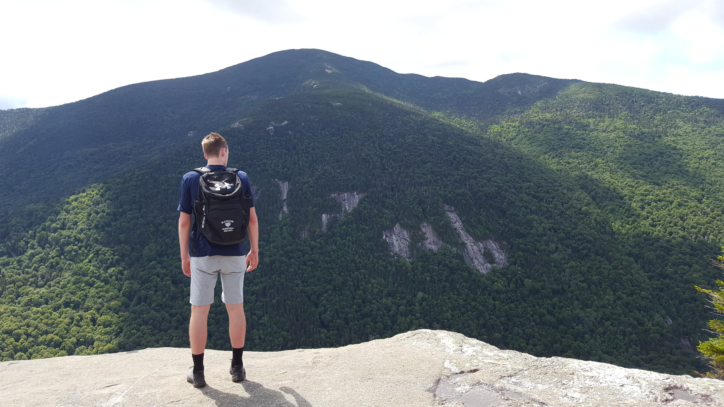Henry looking down into Grafton Notch from Table Rock.