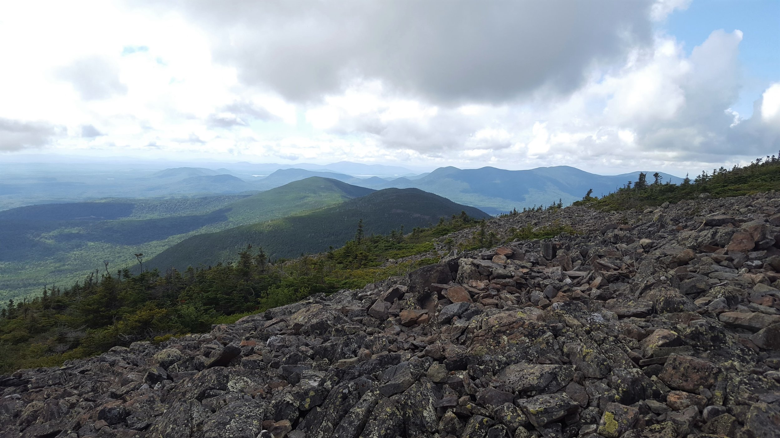 The view west from the summit. Looking across Hay and Gulf Hagas Mountains to the Lily Bay Mountains