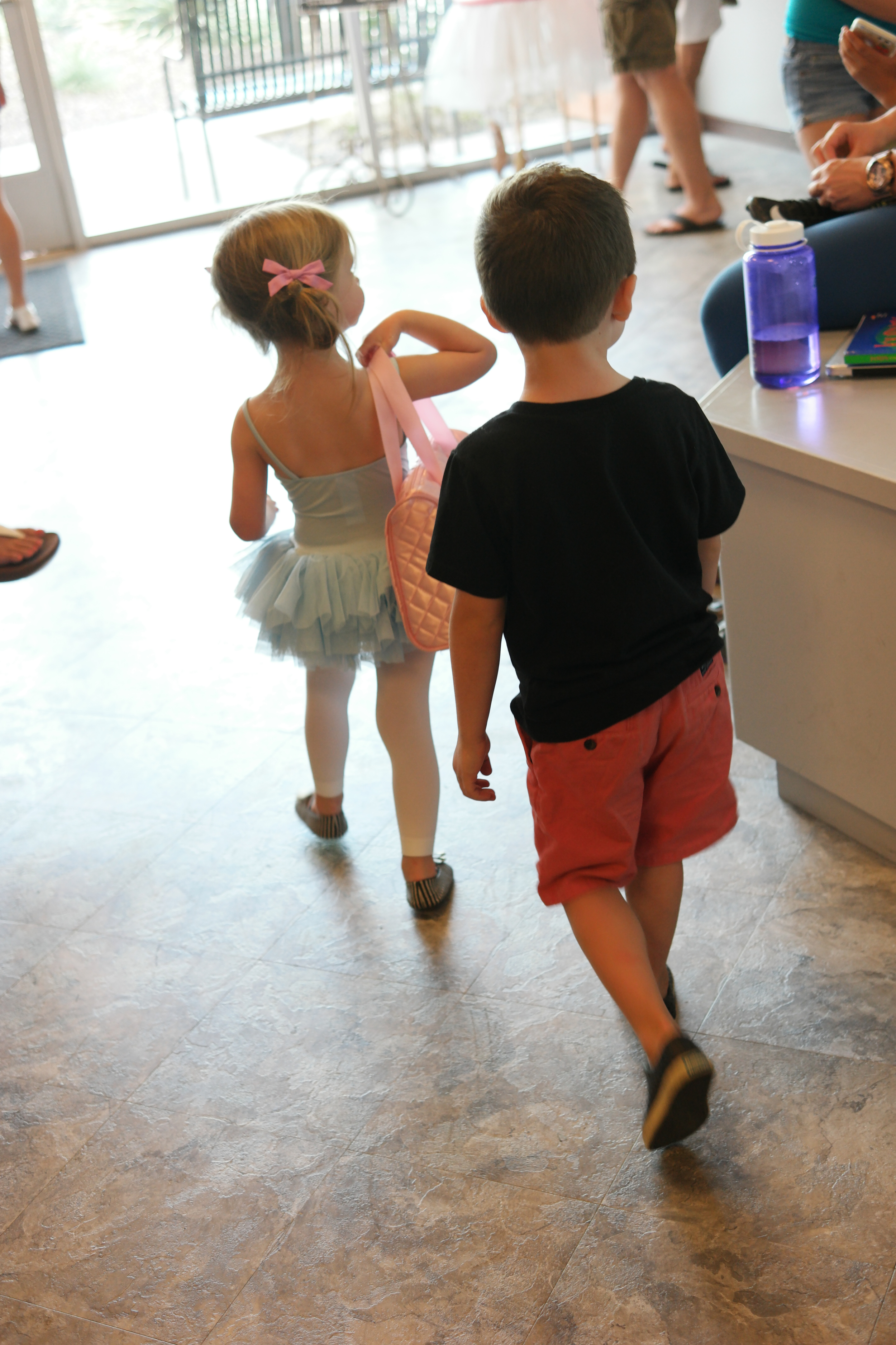 Proud big brother walking out behind Hudson. And can I just always remember her sweet shoulders and back in this moment?!?