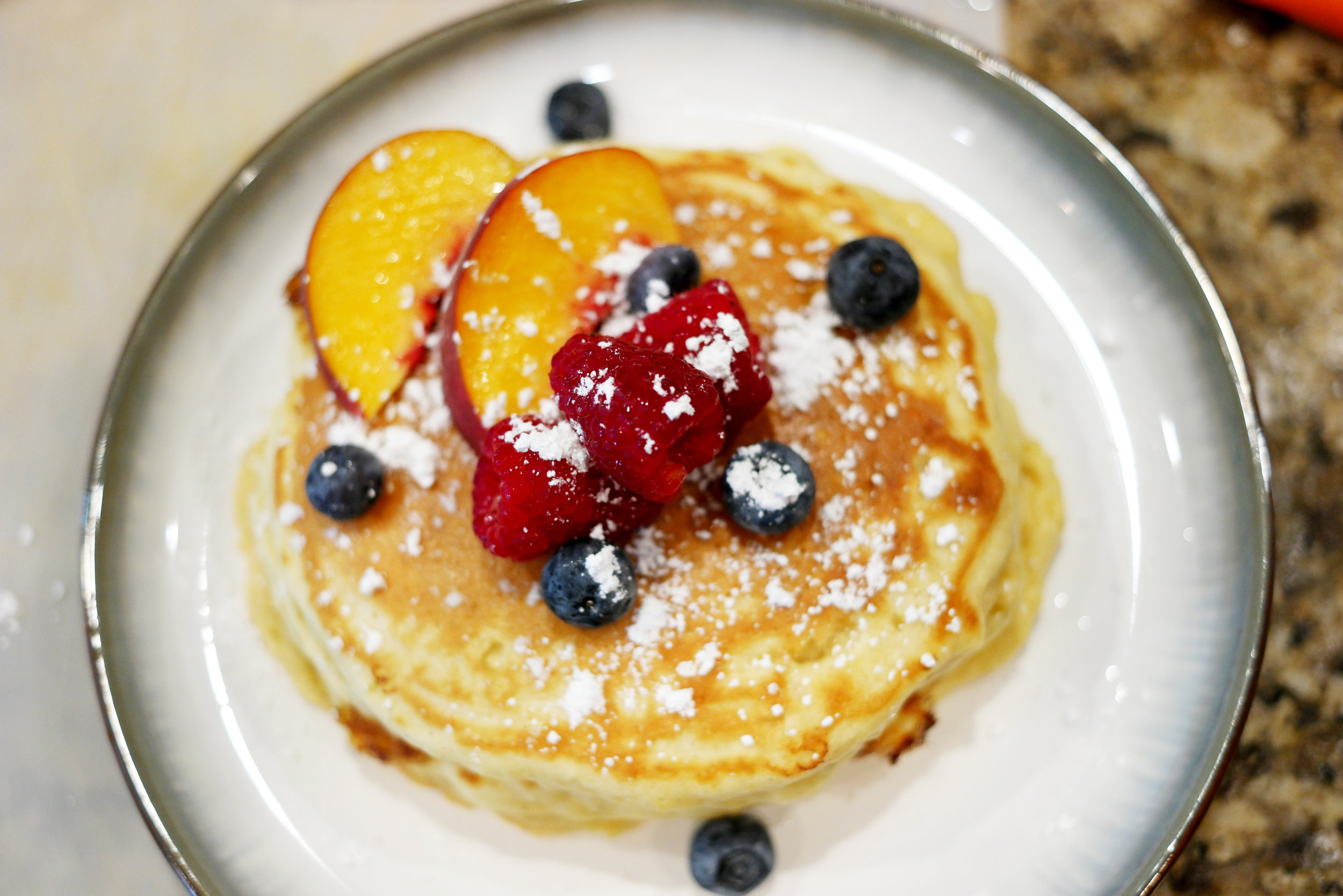 Pic of pancakes with peaches/raspberries for me