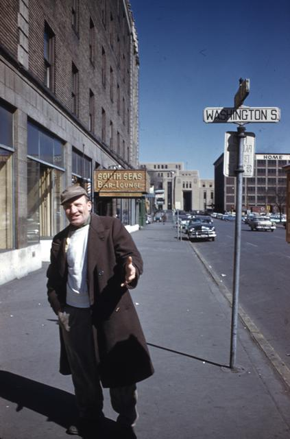 HHM Gateway183-Older man - looks like a resident of the neighborhood along Washington S., South Seas Bar & Lounge in back ground as is Post Office.jpg