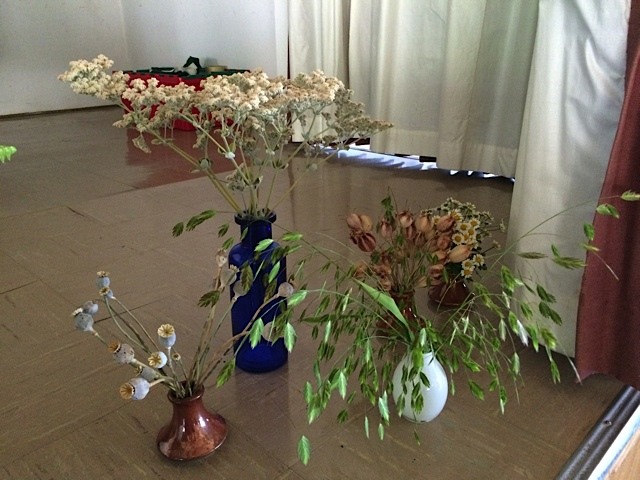 Part of Liz Calhoon's horticultural presentation involved the use of these seed pods and dried flowers including the buckwheat in the blue vase, Erigoneum giganteum, and the Chazmantheum grass, also called N. sea oats.