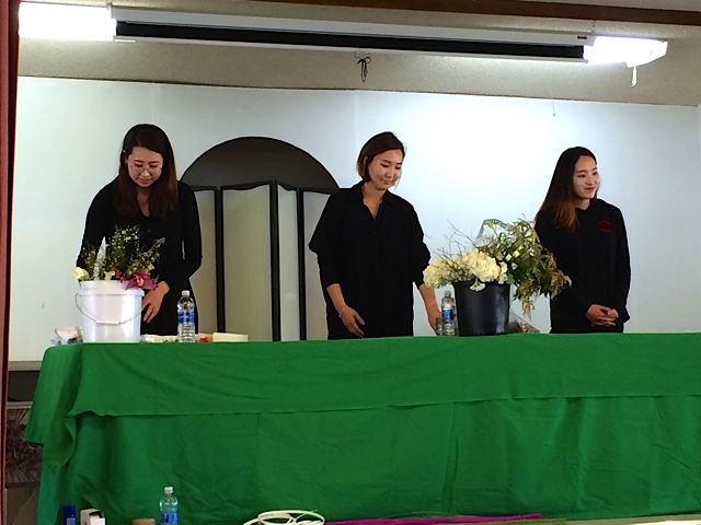 Three South Korean students (Soyeon Kim, Jung Hwa Han, YouBin Kim) In Floral Design at City College of San Jose came to demonstrate their skills as part of the April program Floral Design for an Exuberant Spring