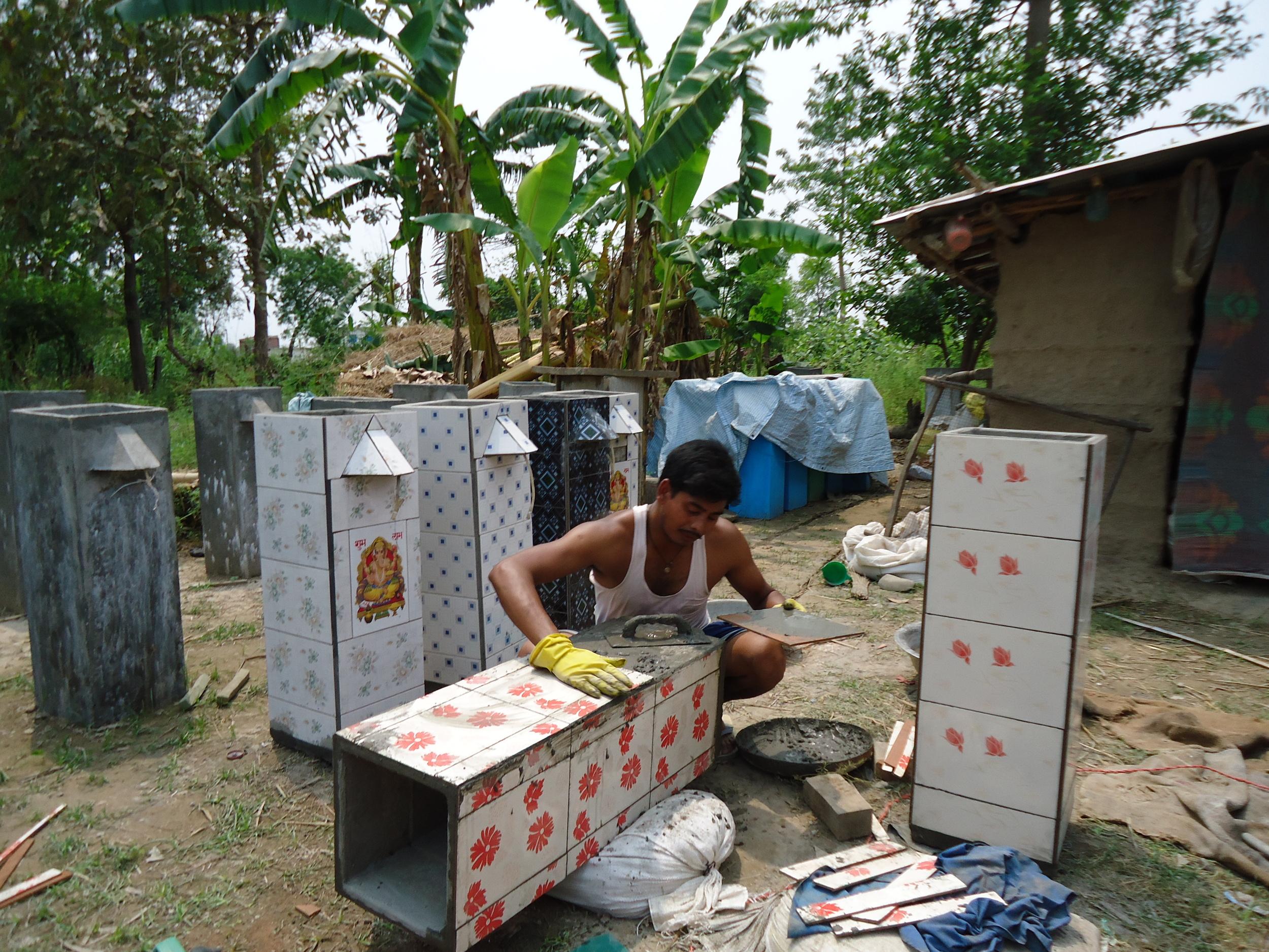 BSF entrepreneur, named Manoj, finishing BSF in Kailali.  (Source: ENPHO) .
