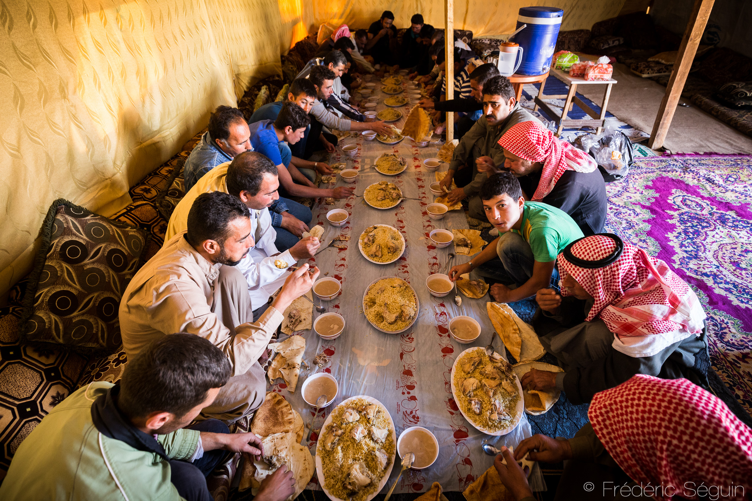 Refugees celebrating Ramadan together in a Syrian refugee camp in Lebanon. Photo credit: Frédéric Séguin,  Lebanon- The Other Side of the Sea .