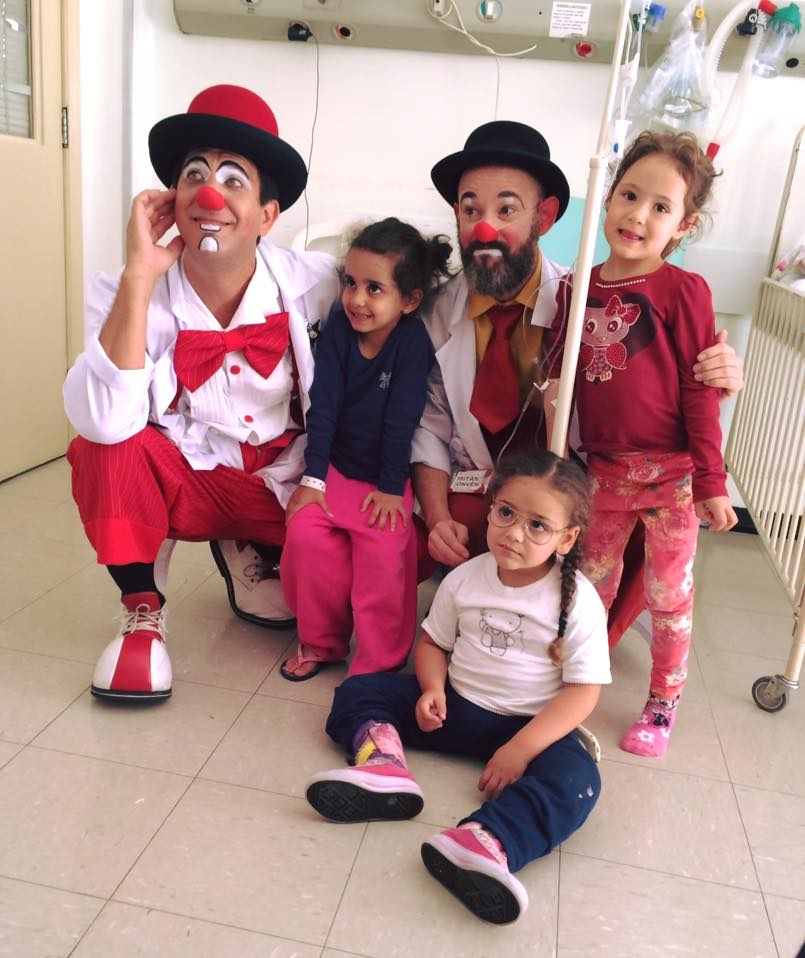 Nogueira with another clown colleague and children from one of their serviced hospitals.  Photo credit:    Doctors of Joy   .