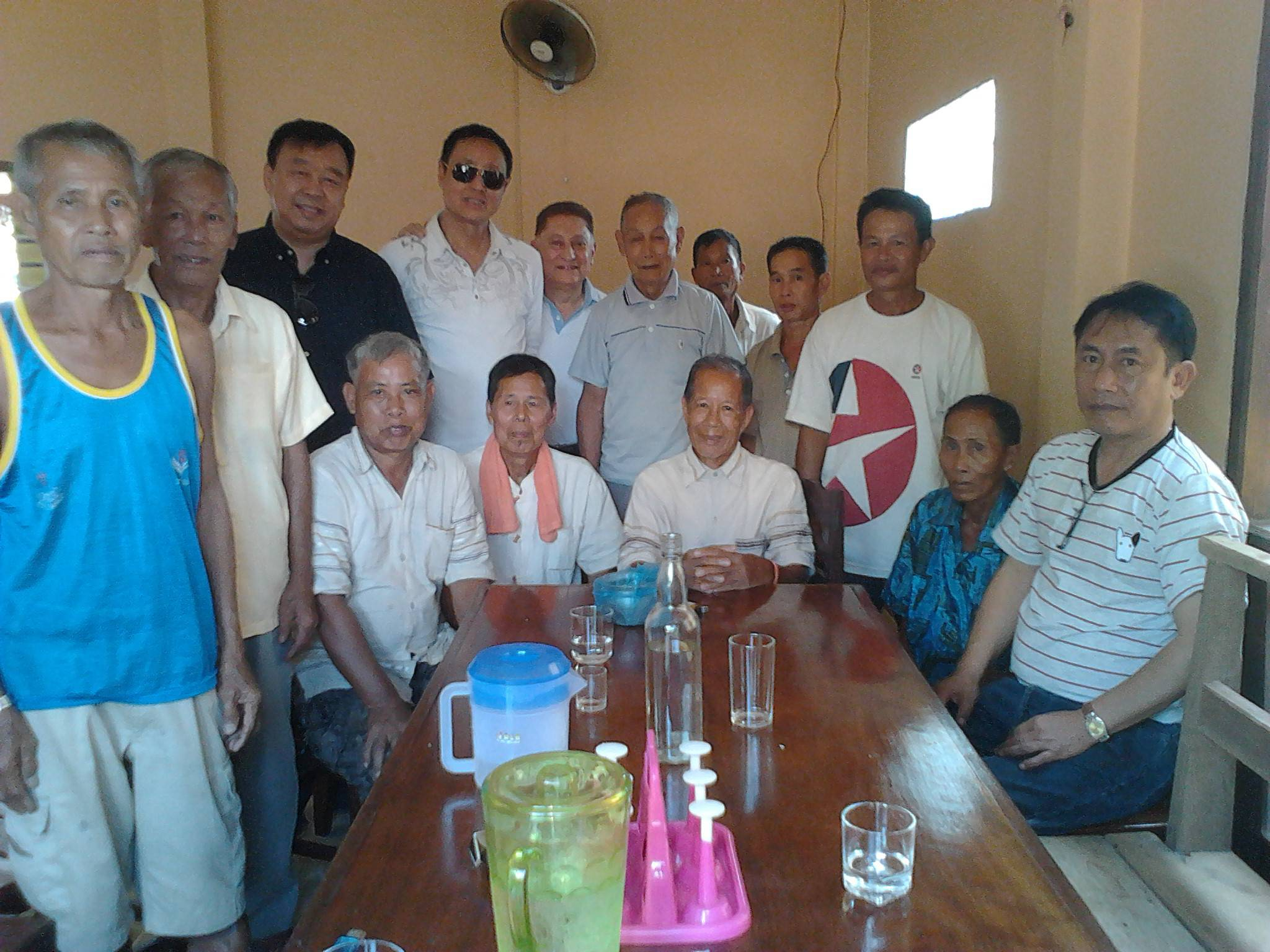With group of farmers in Laos. RL (center back) and Mr. Virasane (extreme right) head of Legacy partner Foundation in Laos.  Photo credit: Rafael Legaria.