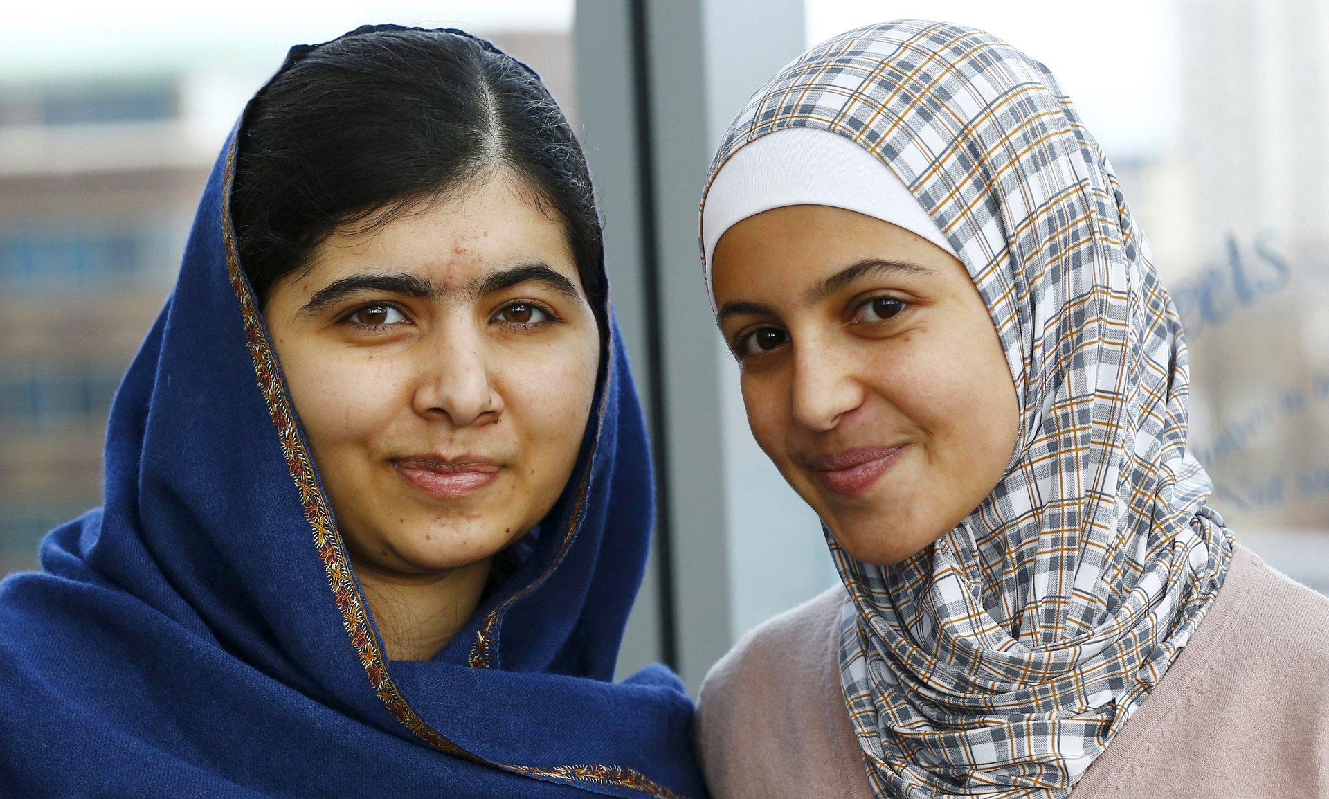 Girls' education advocates Malala Yousafzai, left, and Muzoon Almellehan, right. Photo credit:   Darren Staples/Reuters