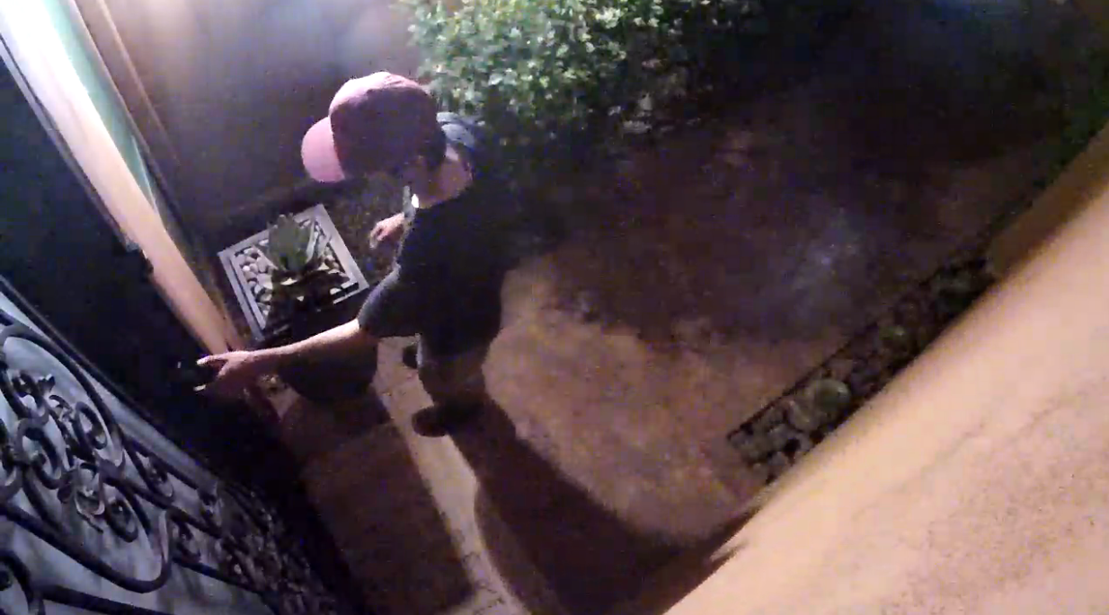Intruder checking for unlocked front doors at 3am caught on video. Police were notified.
