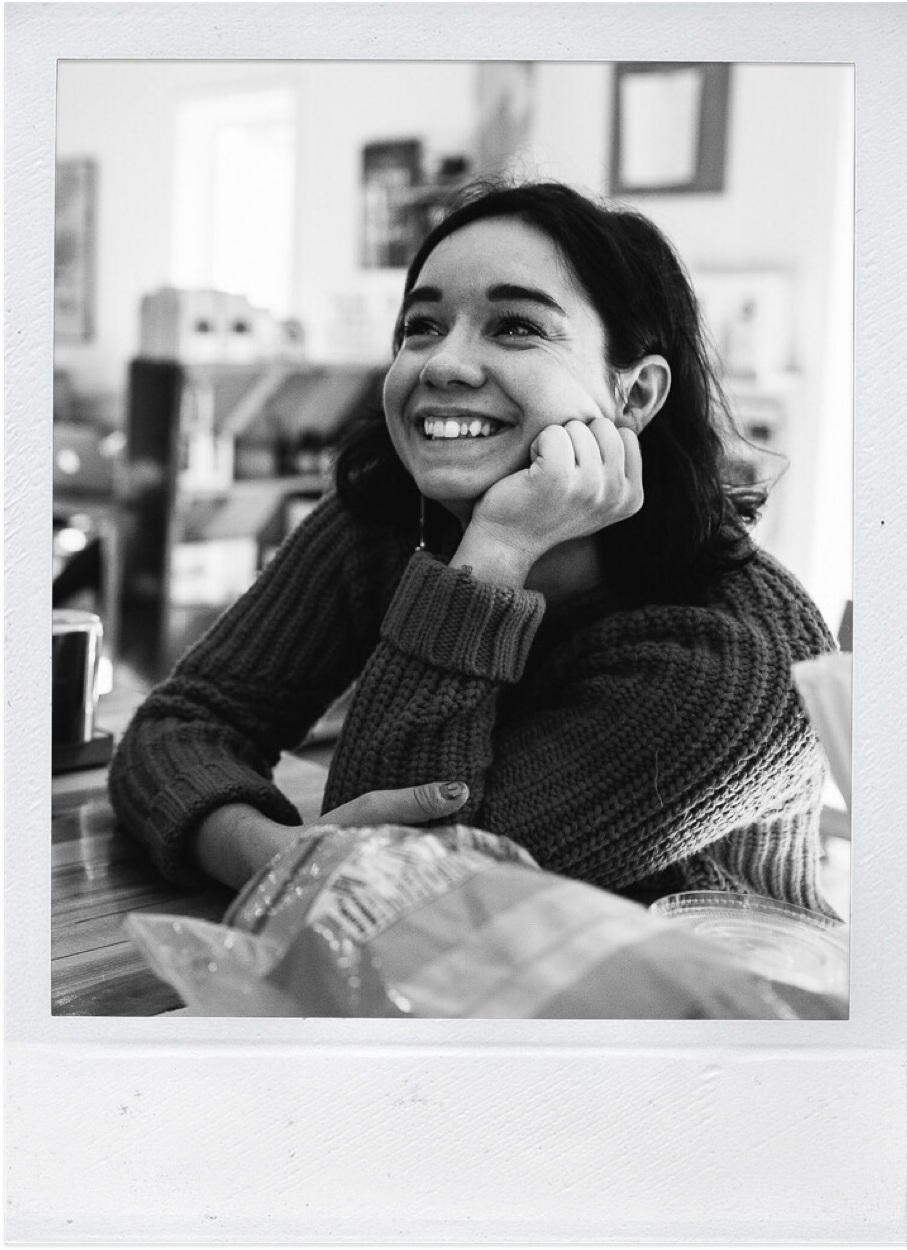 polaroid of woman laughing
