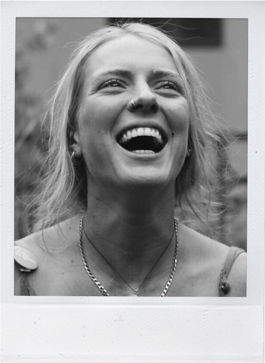 polaroid of woman laughing